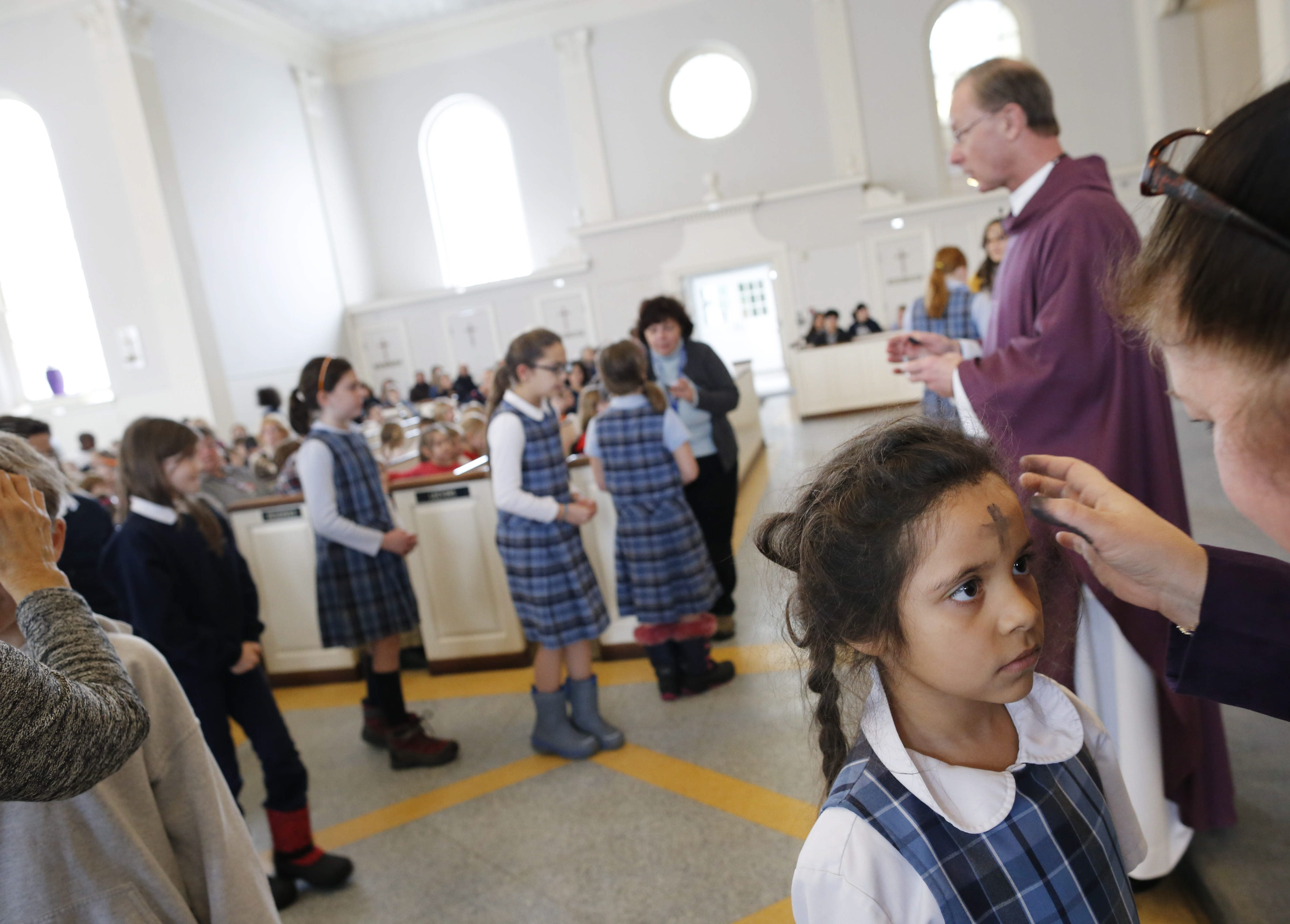 St. John the Baptist School student Johanna Coronel gets her ashes during Ash Wednesday Mass at St. John the Baptist Church, Wednesday, Feb. 10, 2016.
