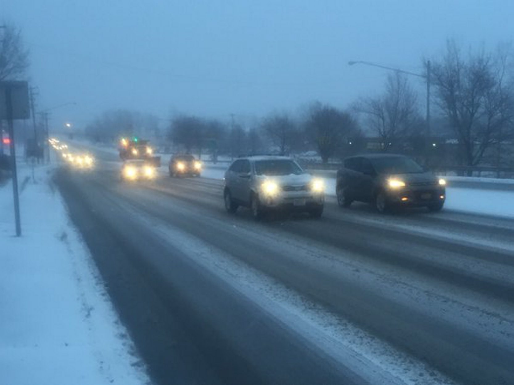 Snow made for slick roads during the morning commute Wednesday, including on Union at French roads. (John Hickey/Buffalo News)
