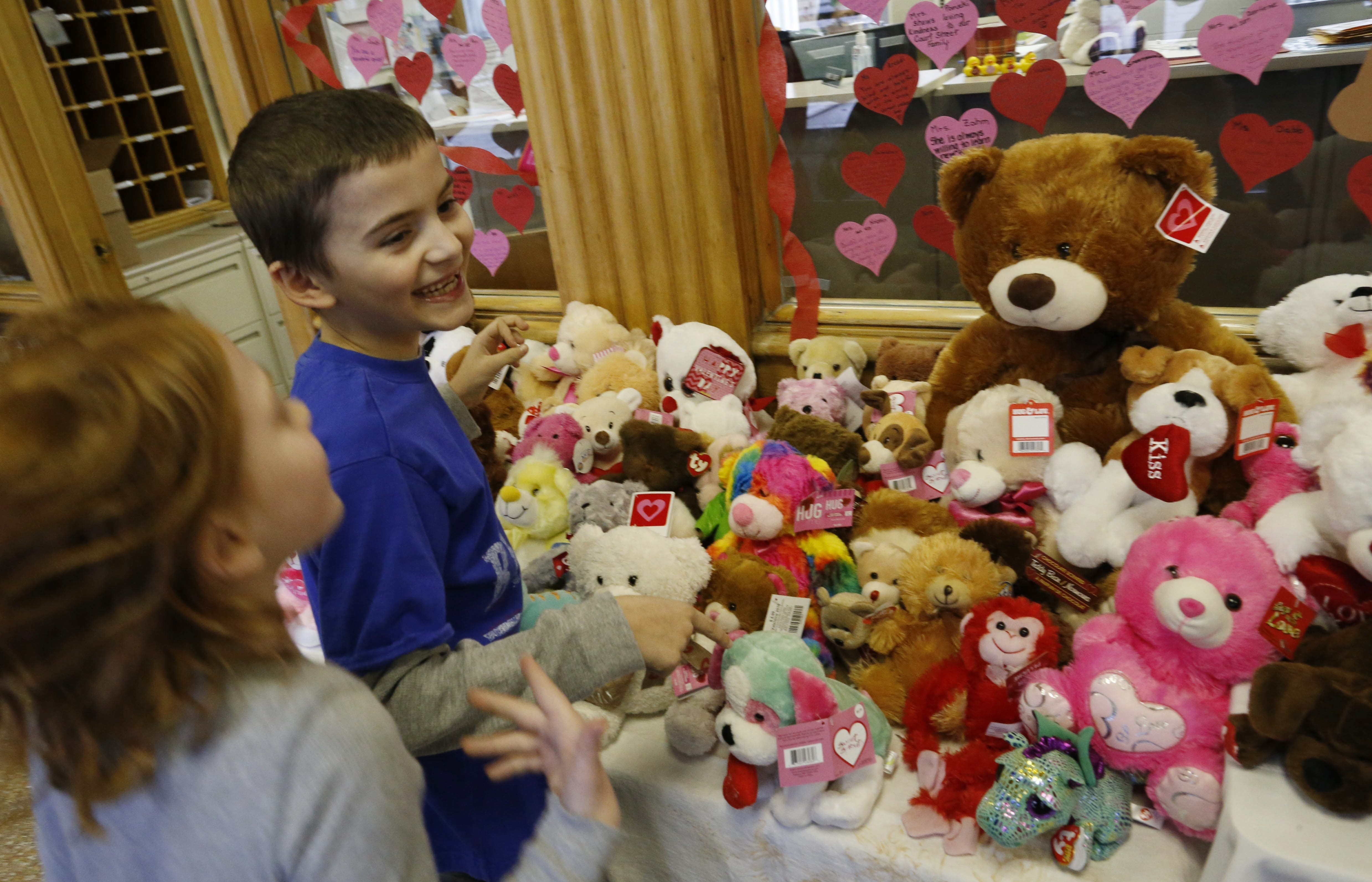 Ty Spinelli and Sarah Amborski, 8-year-old third-grade students at Court Street Elementary School in Lancaster, sort teddy bears Tuesday that students collected to donate to Women & Children's Hospital.