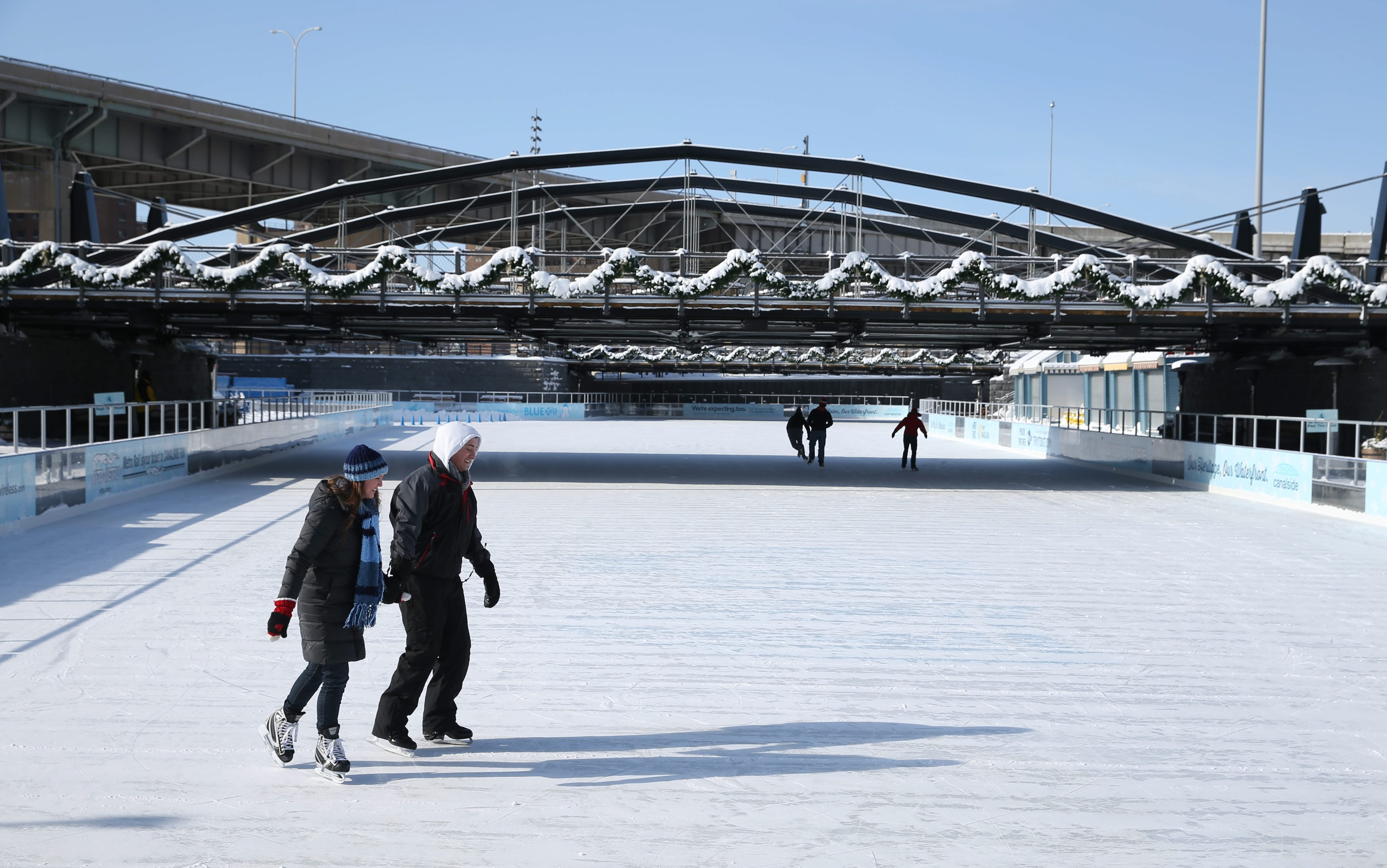 A handful of skaters were on the ice at canalside,  undeterred by the sub zero temperatures, Sunday, Feb. 15, 2015.  Tyler Gopen of West Seneca and his girlfriend Amanda Kohler of Ontario visited the rink for the first time.