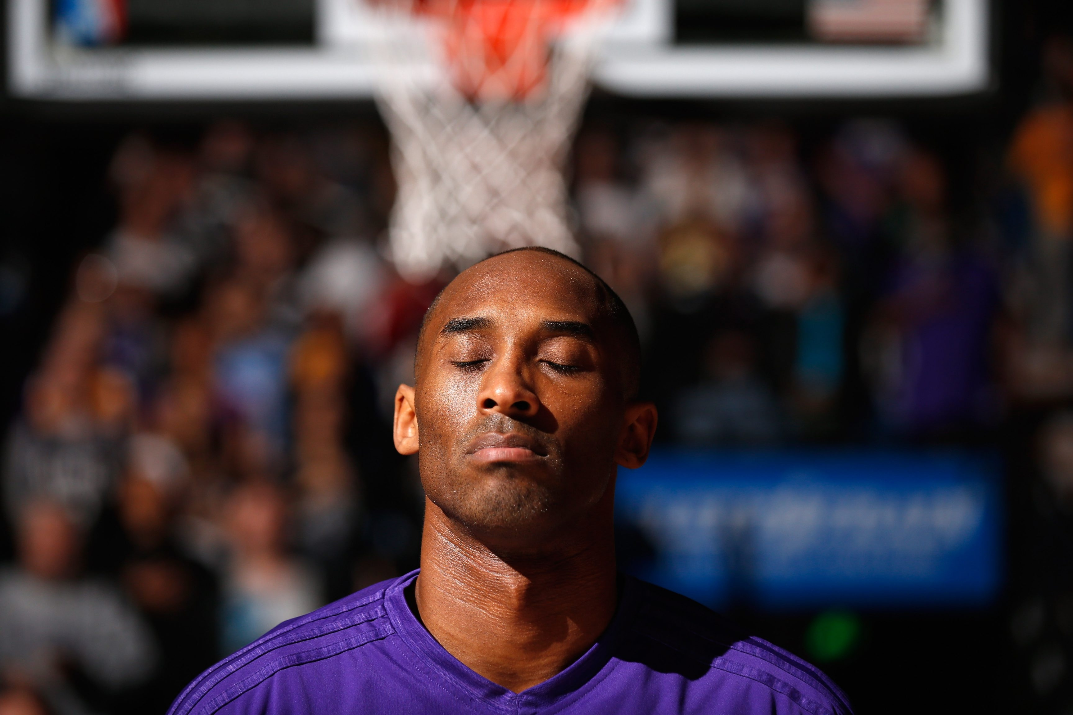 SACRAMENTO, CA - JANUARY 07:  Kobe Bryant #24 of the Los Angeles Lakers stands for the National Anthem before their game against the Sacramento Kings at Sleep Train Arena on January 7, 2016 in Sacramento, California.  NOTE TO USER: User expressly acknowledges and agrees that, by downloading and or using this photograph, User is consenting to the terms and conditions of the Getty Images License Agreement.  (Photo by Ezra Shaw/Getty Images)