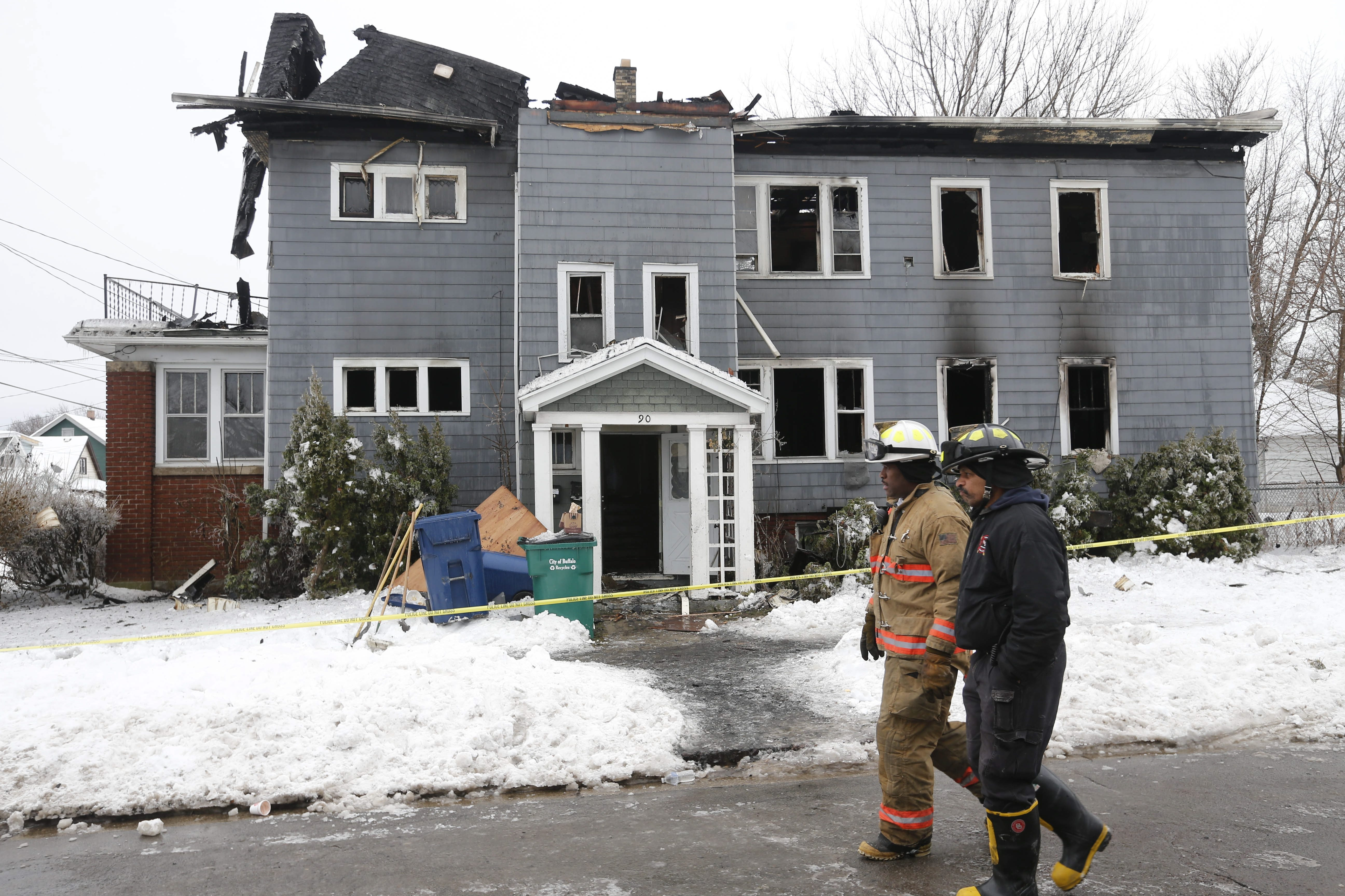 Investigators search for evidence after a fire tore through 90 Humber Ave. early Friday morning, killing two and critically injuring 9-year-old Treasure Brighon.