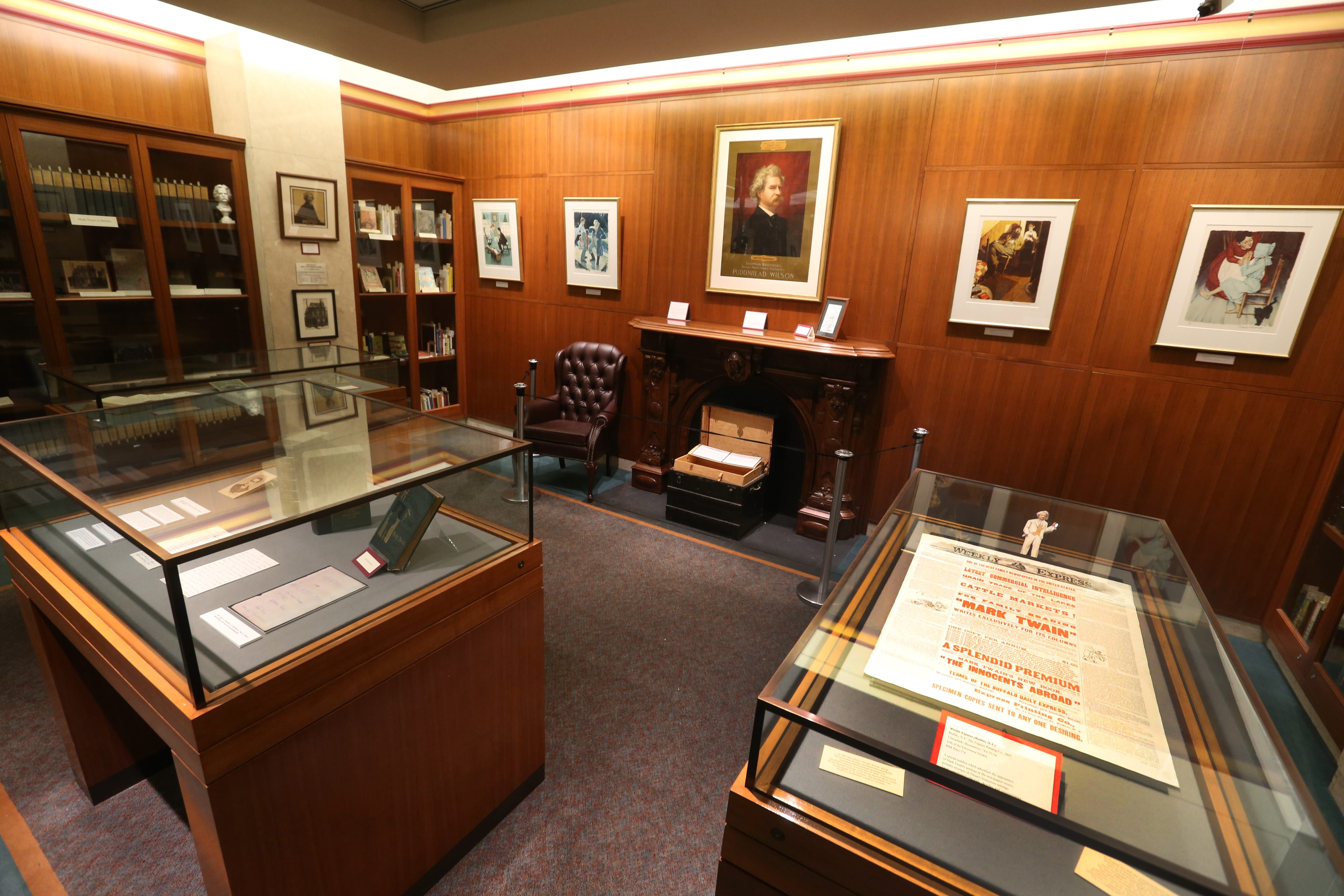 "Twain treasures: The handwritten manuscript to ""The Adventures of Huckleberry Finn"" and other translations of the novel are among the artifacts in the Mark Twain Room. Other curiosities include a box of cigars bearing Twain's picture and the words ""Known To Many – Loved By All."""