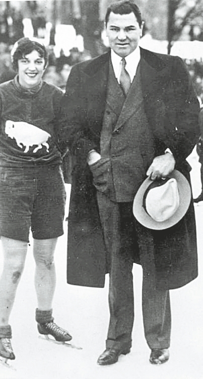 """Catherine """"Kit"""" Klein stands with Jack Dempsey in Delaware Park in February 1931."""