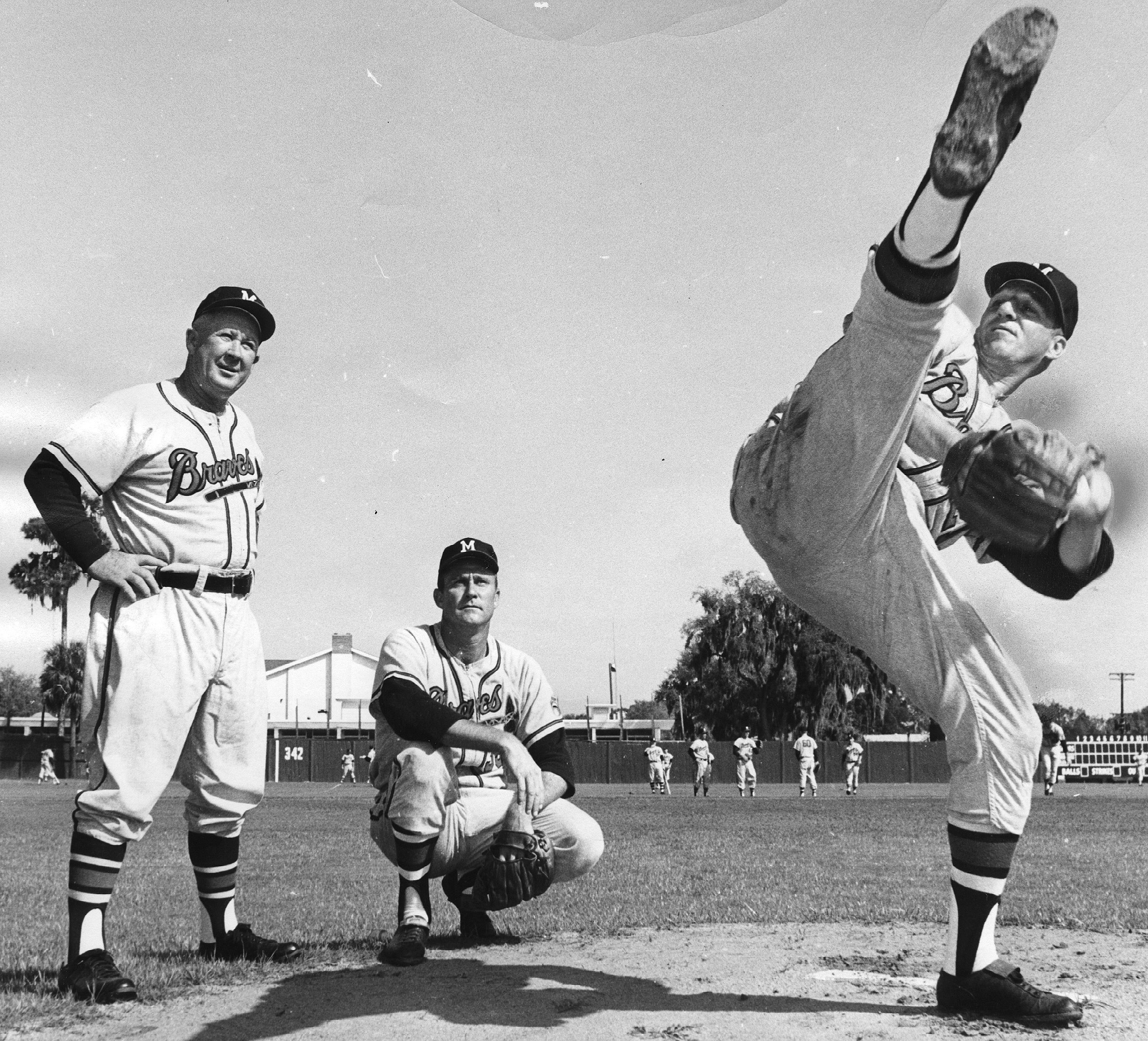 A towering leg kick characterized Warren Spahn's pitching motion and challenged writers to find the words to describe it.