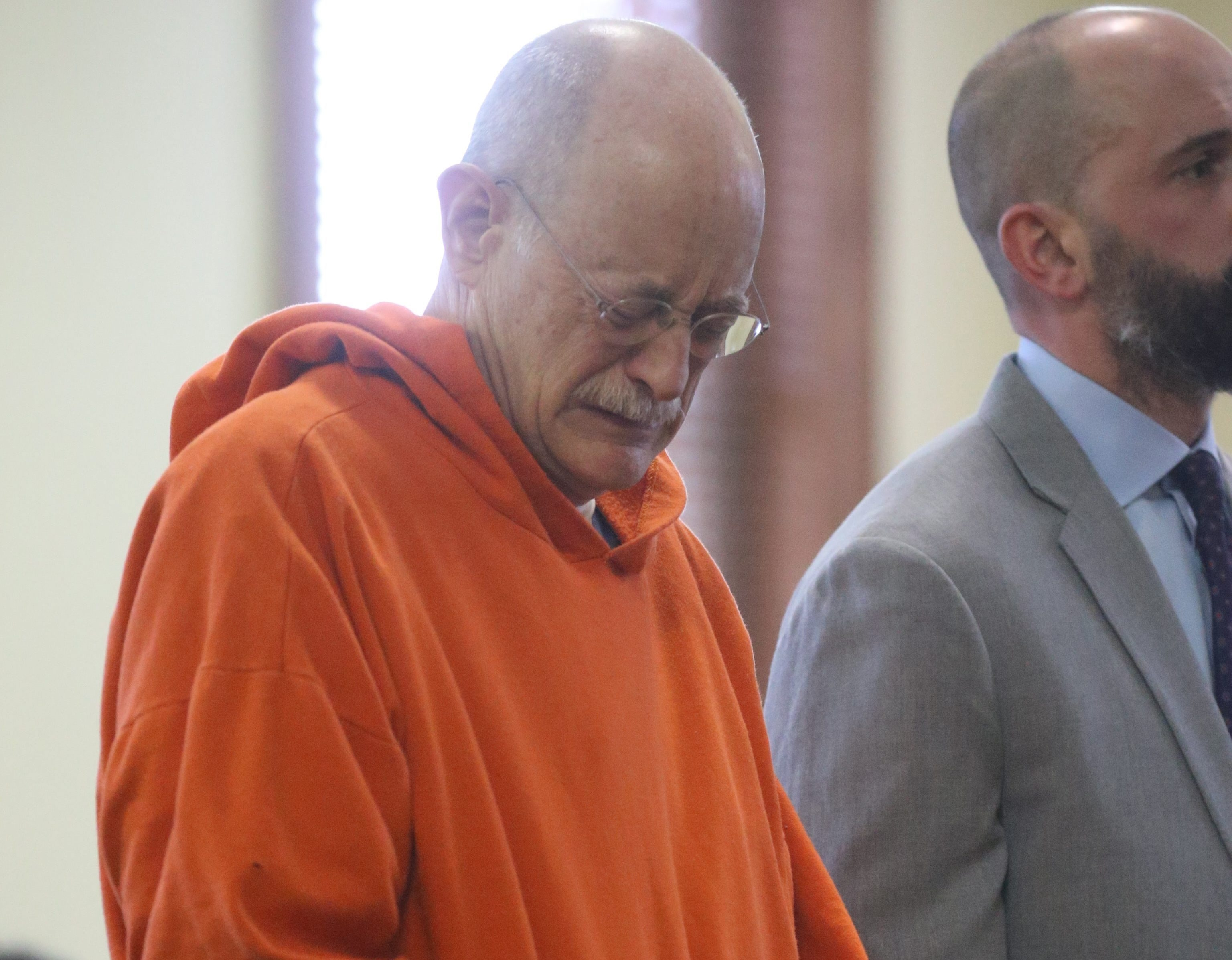 Iver J. Phallen gets emotional Thursday in Niagara County Court in Lockport.