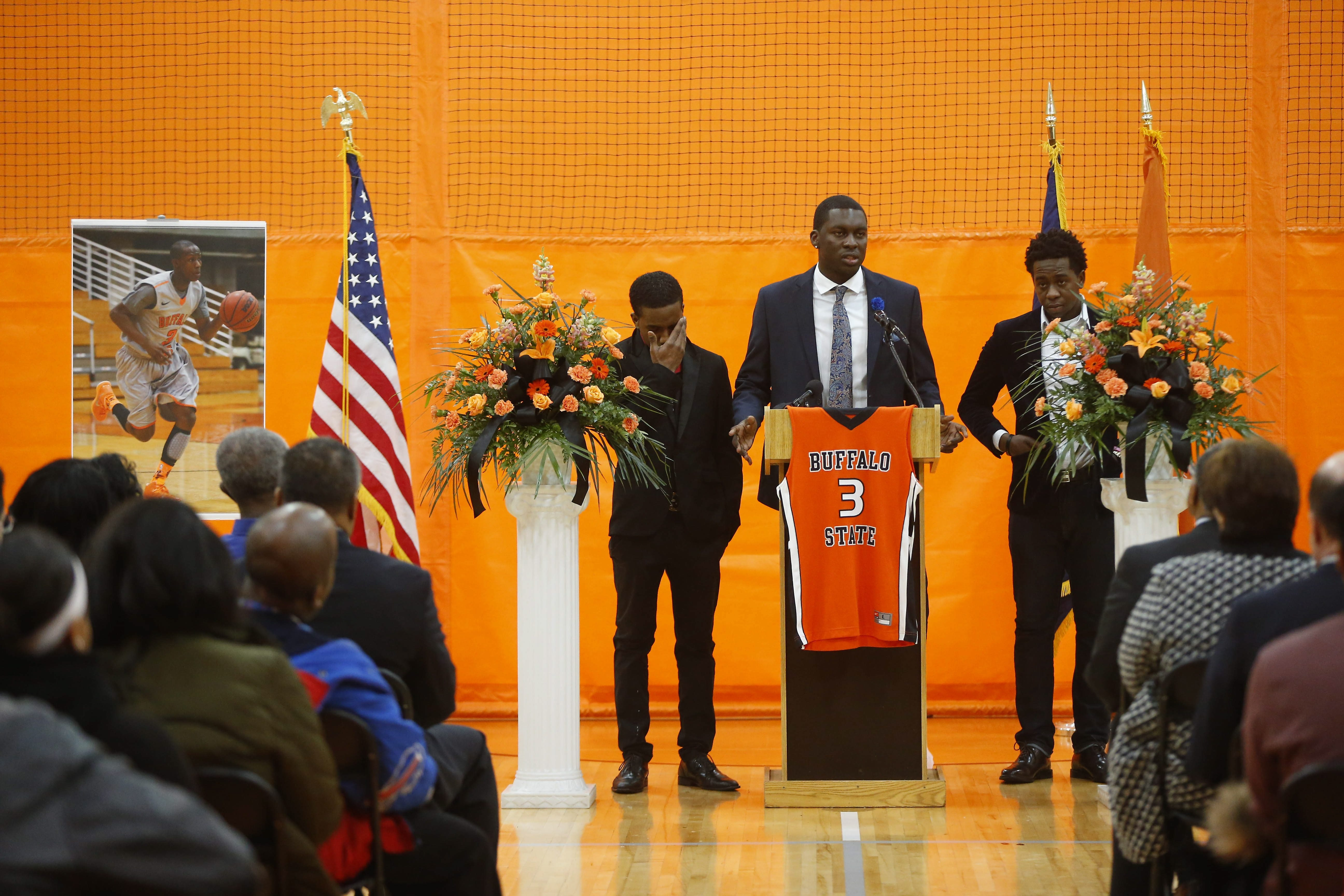 """Peter Murphy, president of the Caribbean Students Organization, speaks during a memorial service held Wednesday at Buffalo State's Houston Gym for former student Bradley D'Oyley, who was known as the """"Dance Hall King"""" among the Caribbean group."""