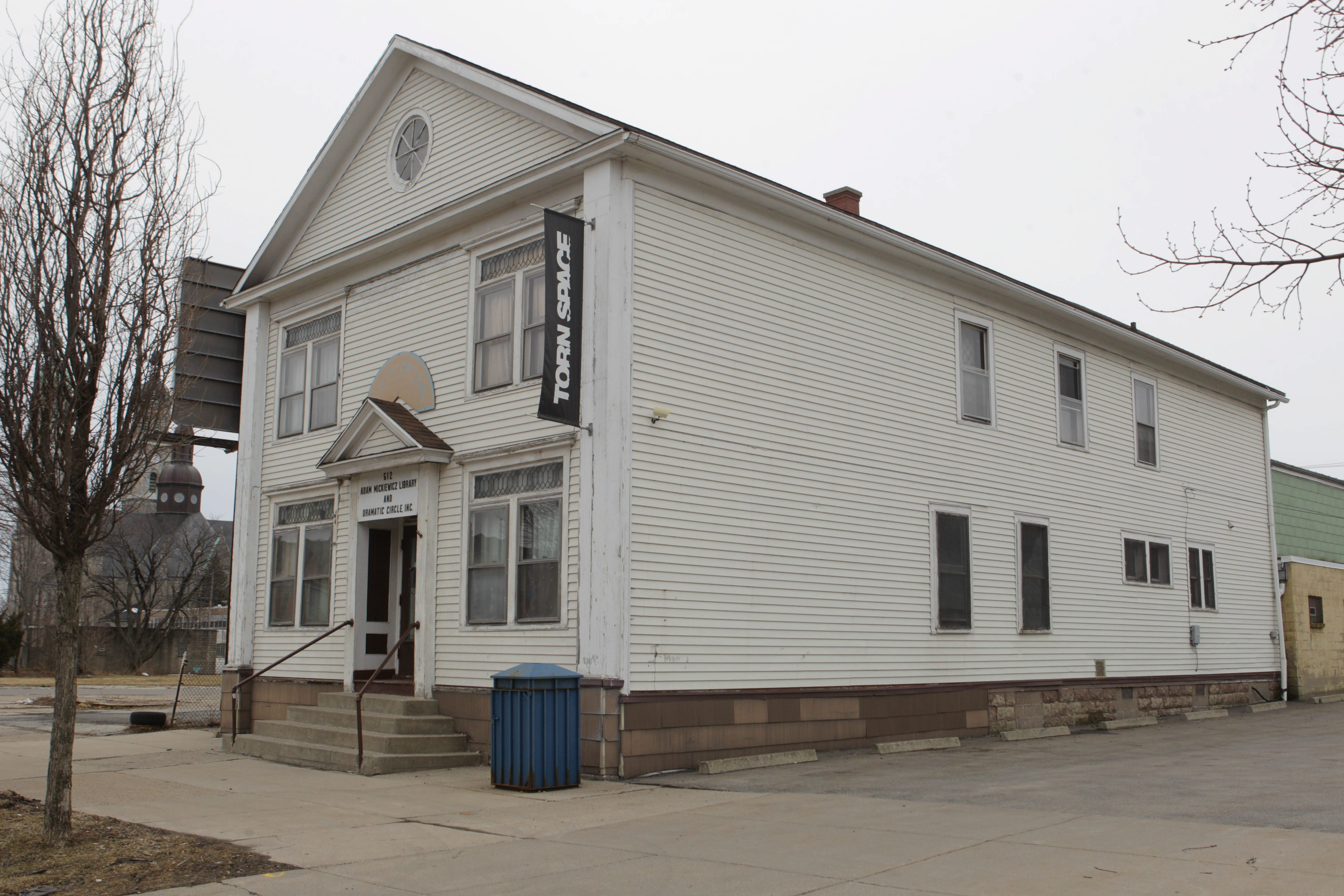Torn Space Theater, at Mickiewicz Library since '01, aims to revive former gas station and store next door.