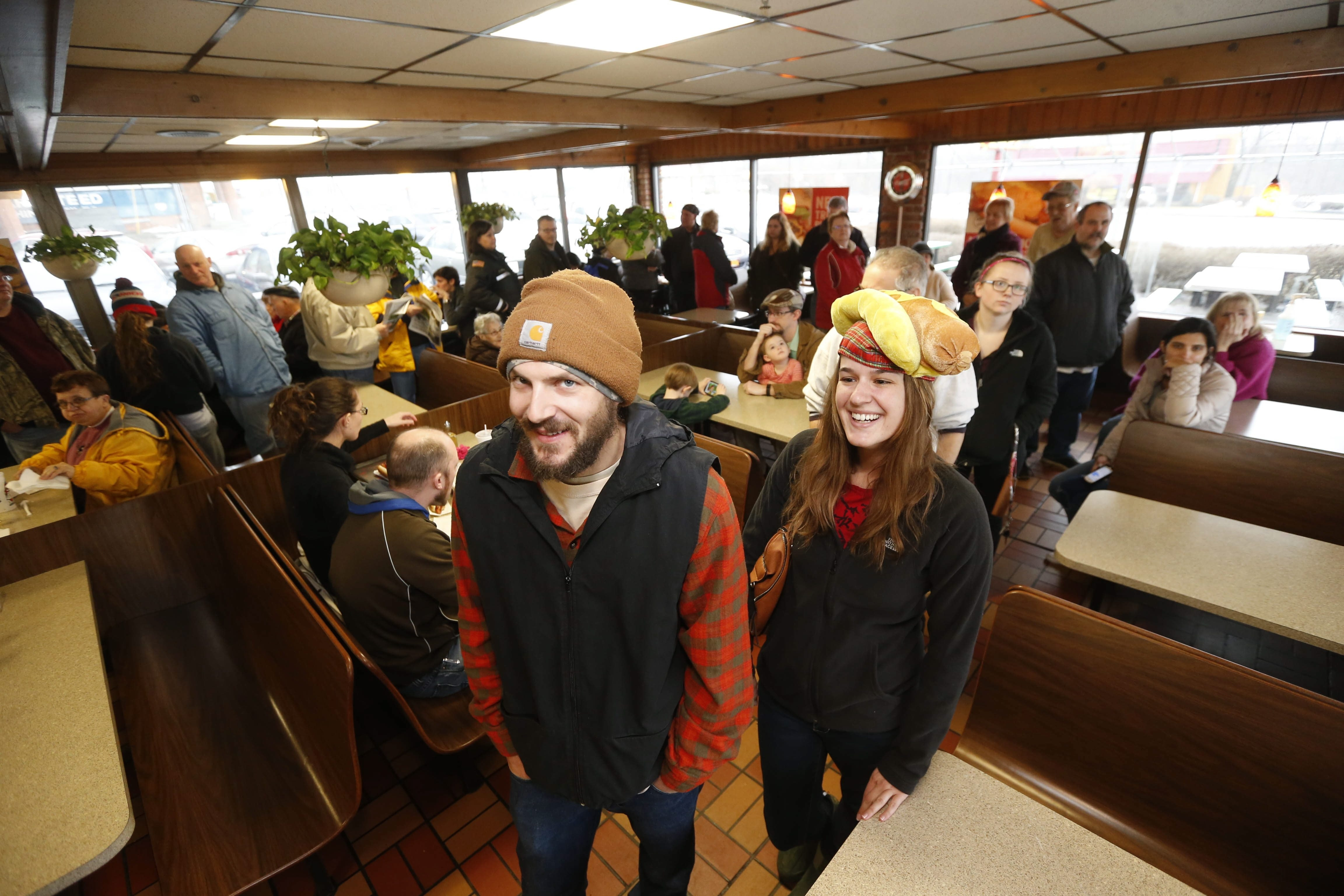 Hot dog fans Michael Murray, of West Falls, and his girlfriend Rebecca Schafer, of Colden, wearing her prized hot dog hat, stood in line for close to two hours to get some franks during the Ted's Hot Dogs customer appreciation $1 hot dog deal today at their Orchard Park location onThursday, Feb. 25, 2016.  (Robert Kirkham/Buffalo News)