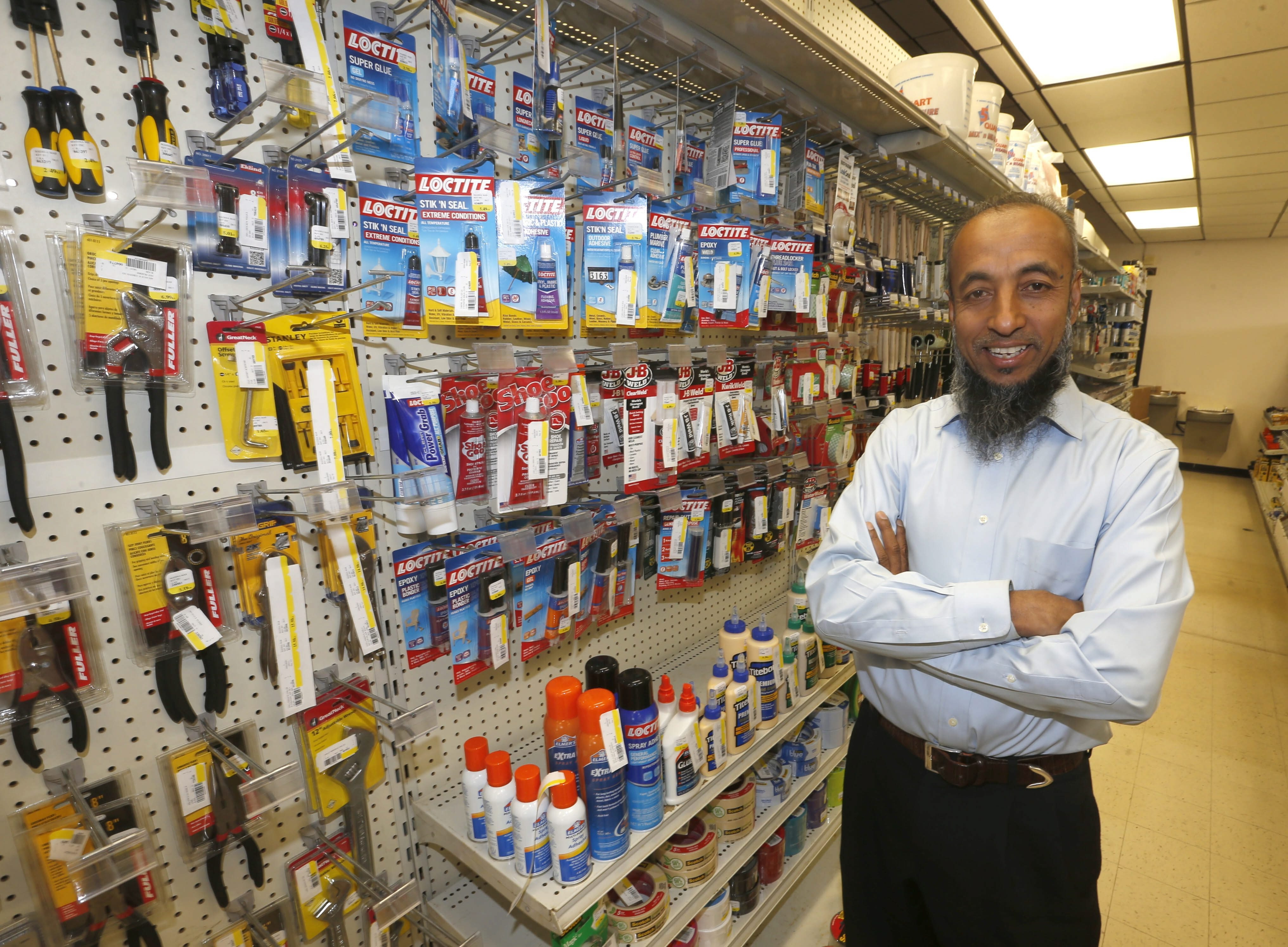 New owner of the old library building on Broadway turned hardware store, Atiqur Rahman,  on Friday, Oct. 2, 2015.  (Robert Kirkham/Buffalo News)