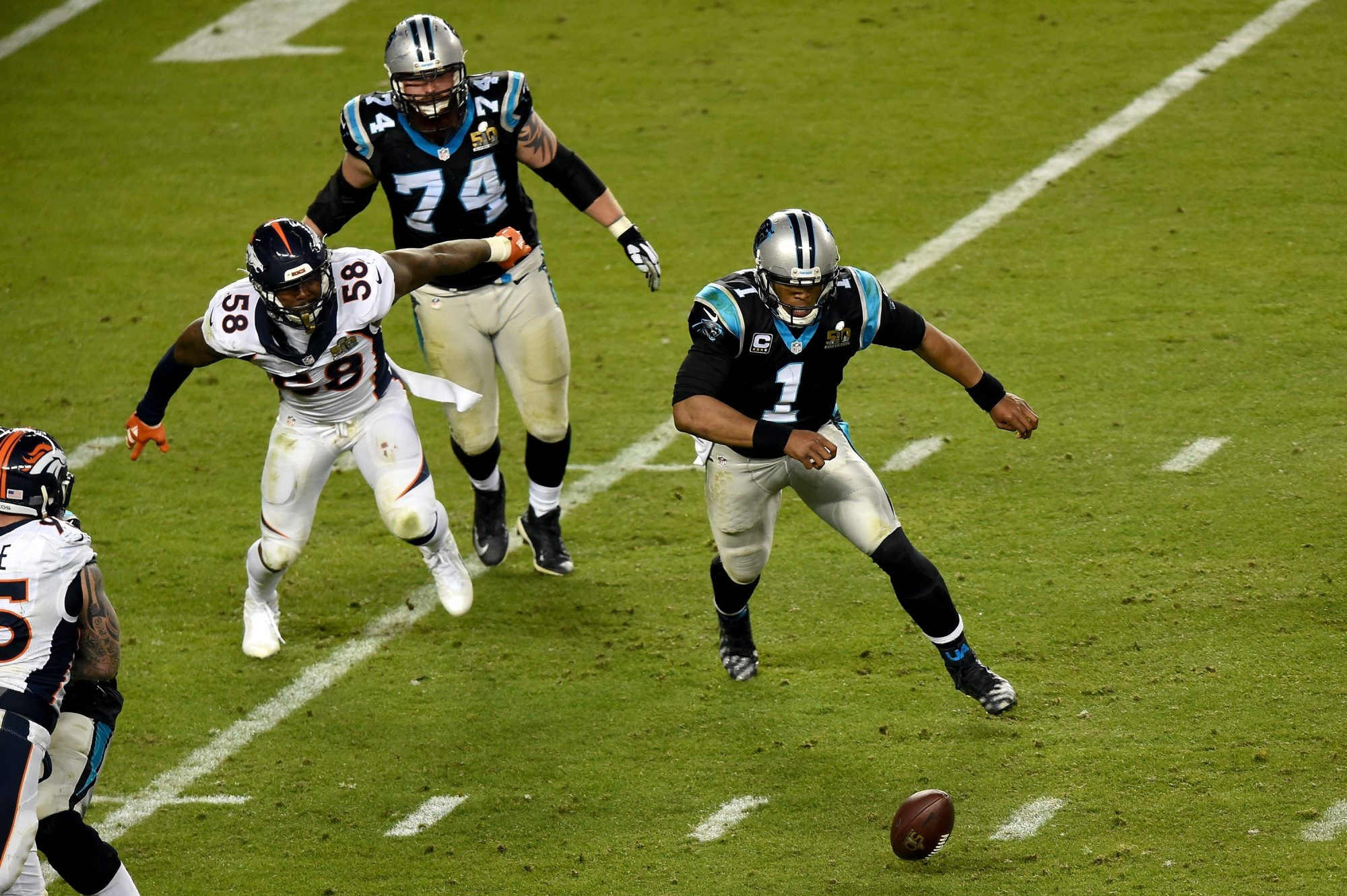 Cam Newton of the Carolina Panthers chases his fumble caused by Denver's Von Miller in what has become a controversial play in Super Bowl 50.