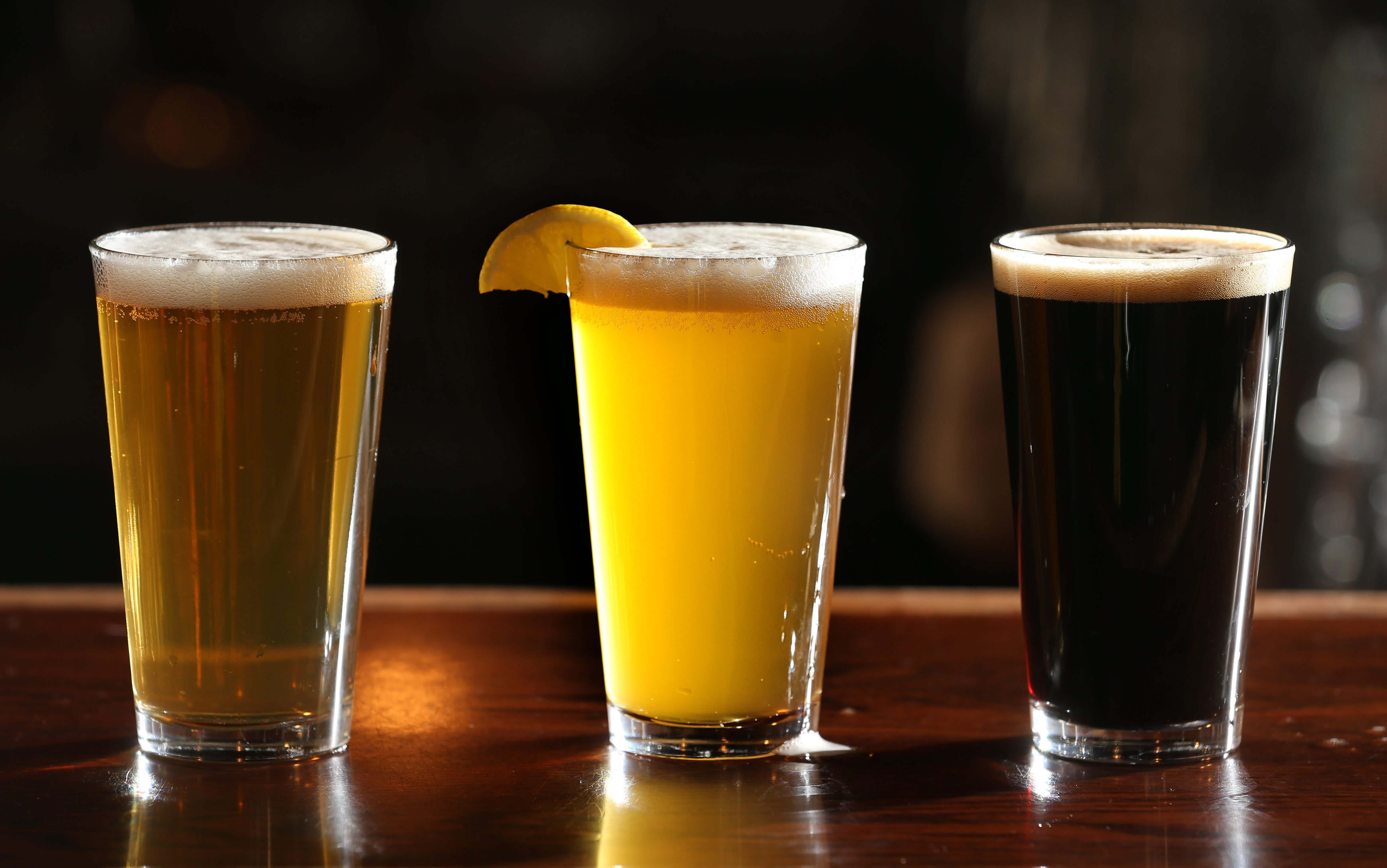 Pearls Street Grill & Brewery head brewer Chris Herr points our some health benefits one can get from drinking beer in moderation.   Beers from left are Lighthouse Golden Ale, Wild Ox Wheat and Street Brawler Oatmeal Stout. Photo taken, Monday, Feb. 1, 2016.  (Sharon Cantillon/Buffalo News)