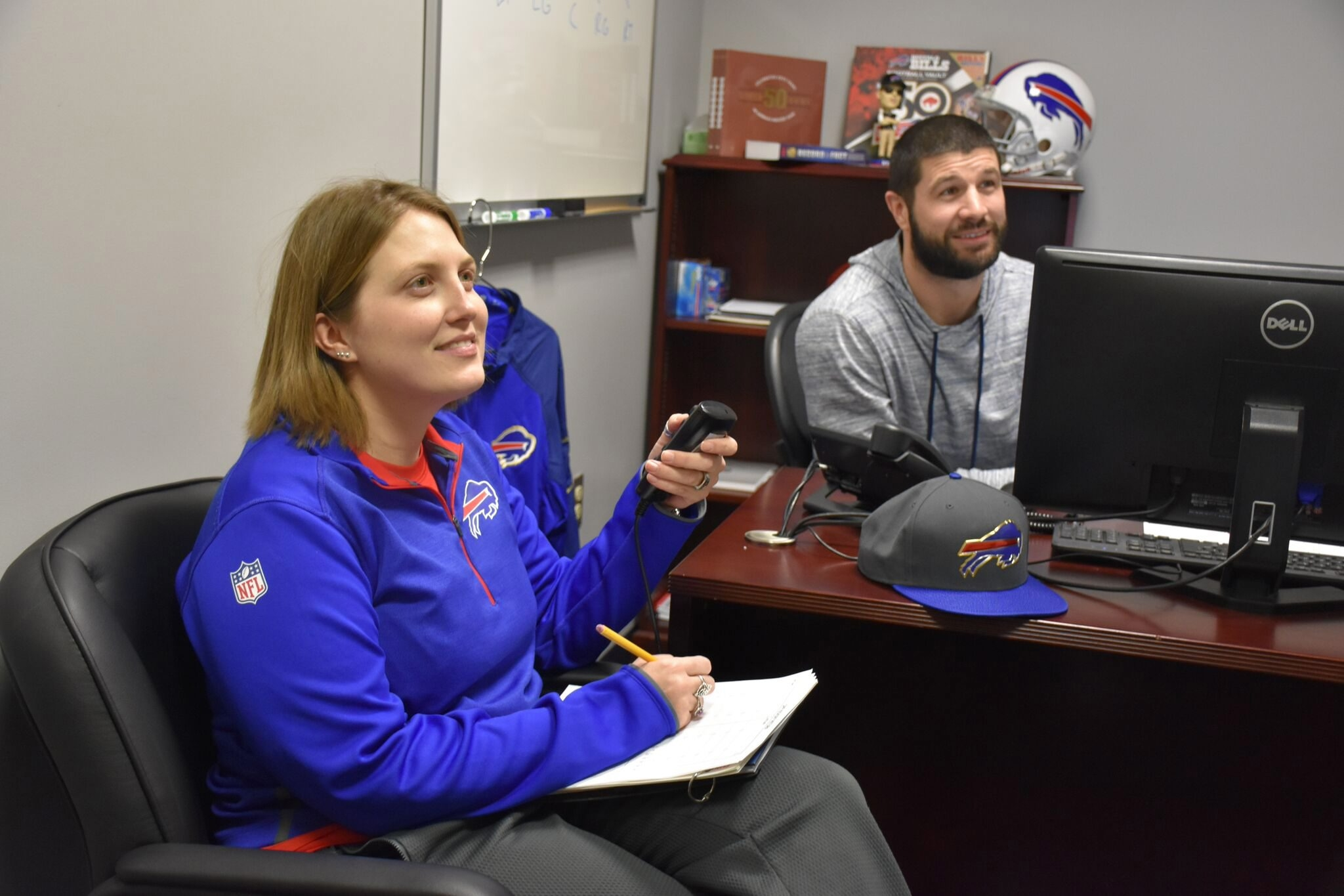 Kathryn Smith, left, was hired by the Bills as an assistant coach, but will there be more women executives in the NFL?