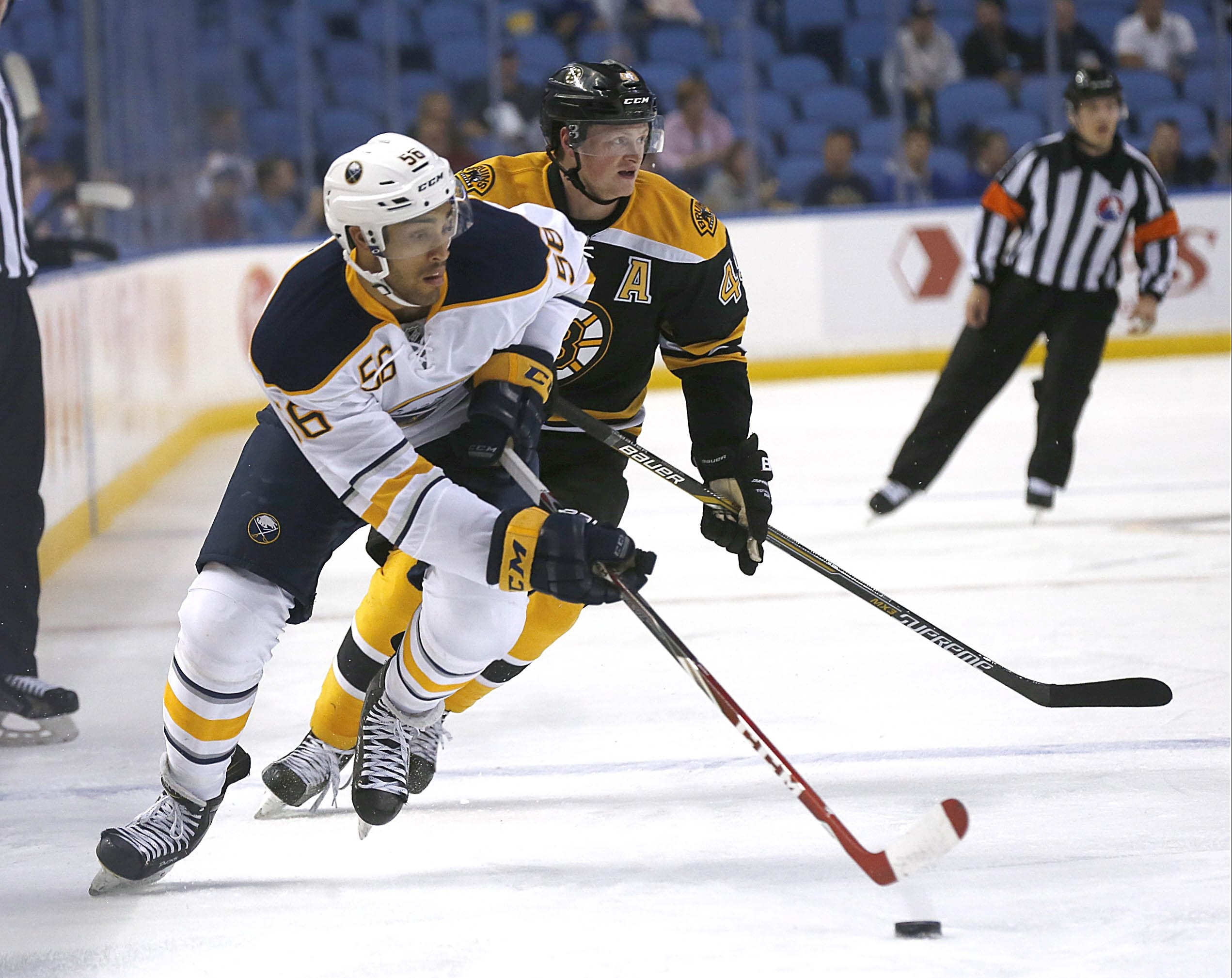 Buffalo's forward prospect Justin Bailey, left, gets past Boston's Linus Arnesson at First Niagara Center on Sept. 14, 2015.