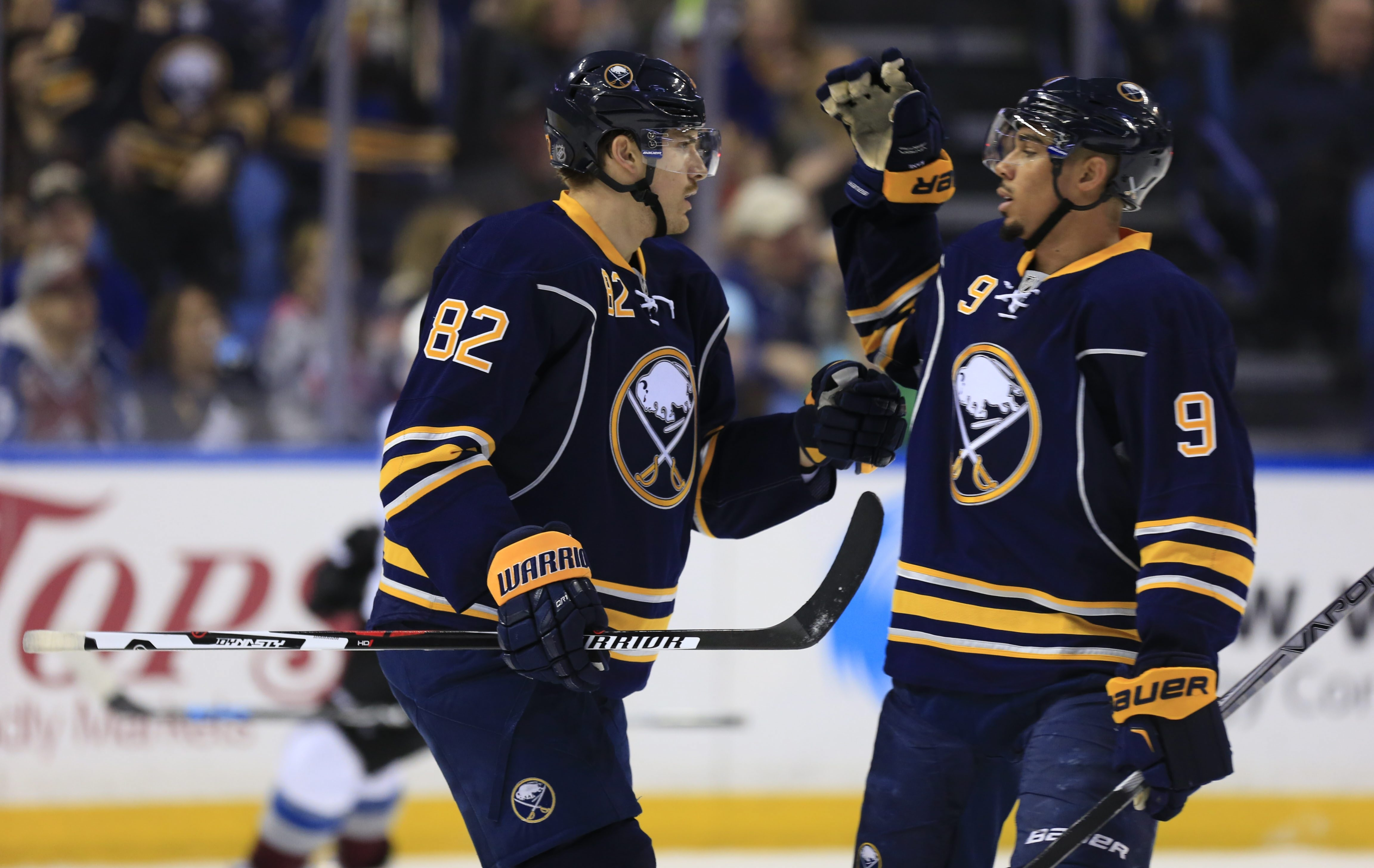 Evander Kane (right) celebrates his goal Sunday against Colorado (Harry Scull Jr/Buffalo News).