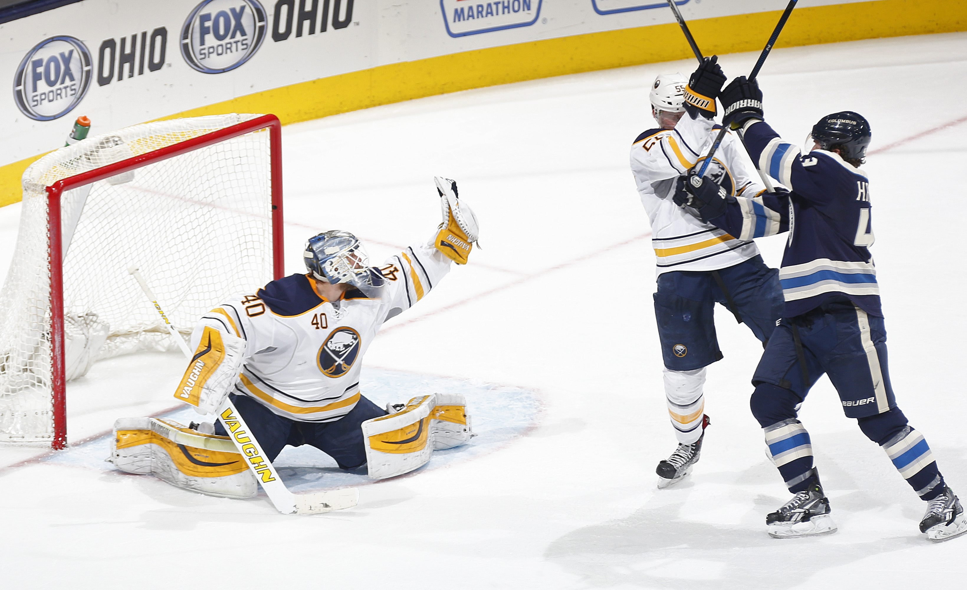 Sabres goalie Robin Lehner grabs the puck Friday as Blue Jackets left wing Scott Hartnell and Sabres defenseman Rasmus Ristolainen battle in front of the net at Nationwide Arena.
