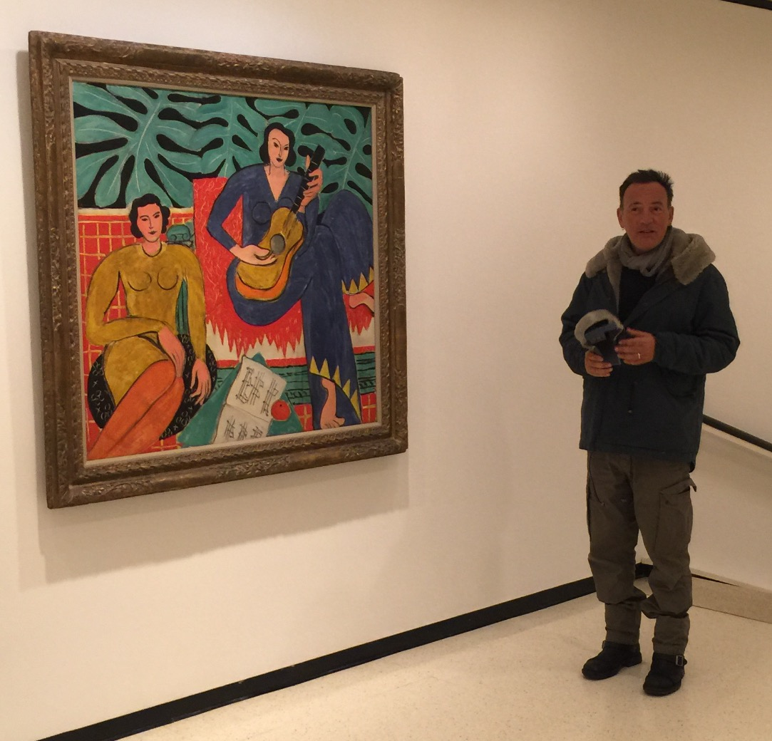 Bruce Springsteen poses for a picture next to Henri Matisse's painting 'La Musique' on Friday afternoon.