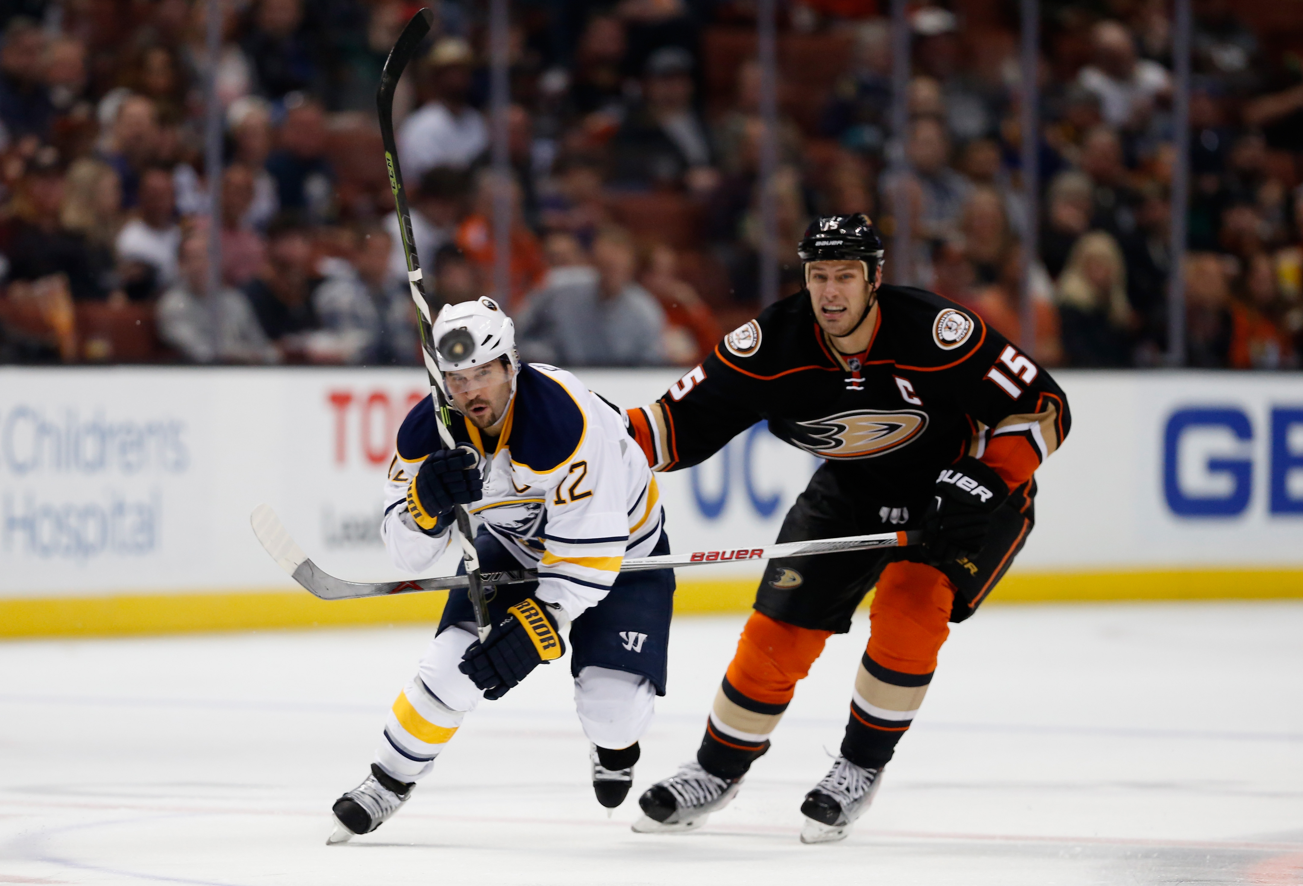 Brian Gionta of the Sabres and Ryan Getzlaf of the Ducks track a loose puck in the first period Wednesday (Getty Images).