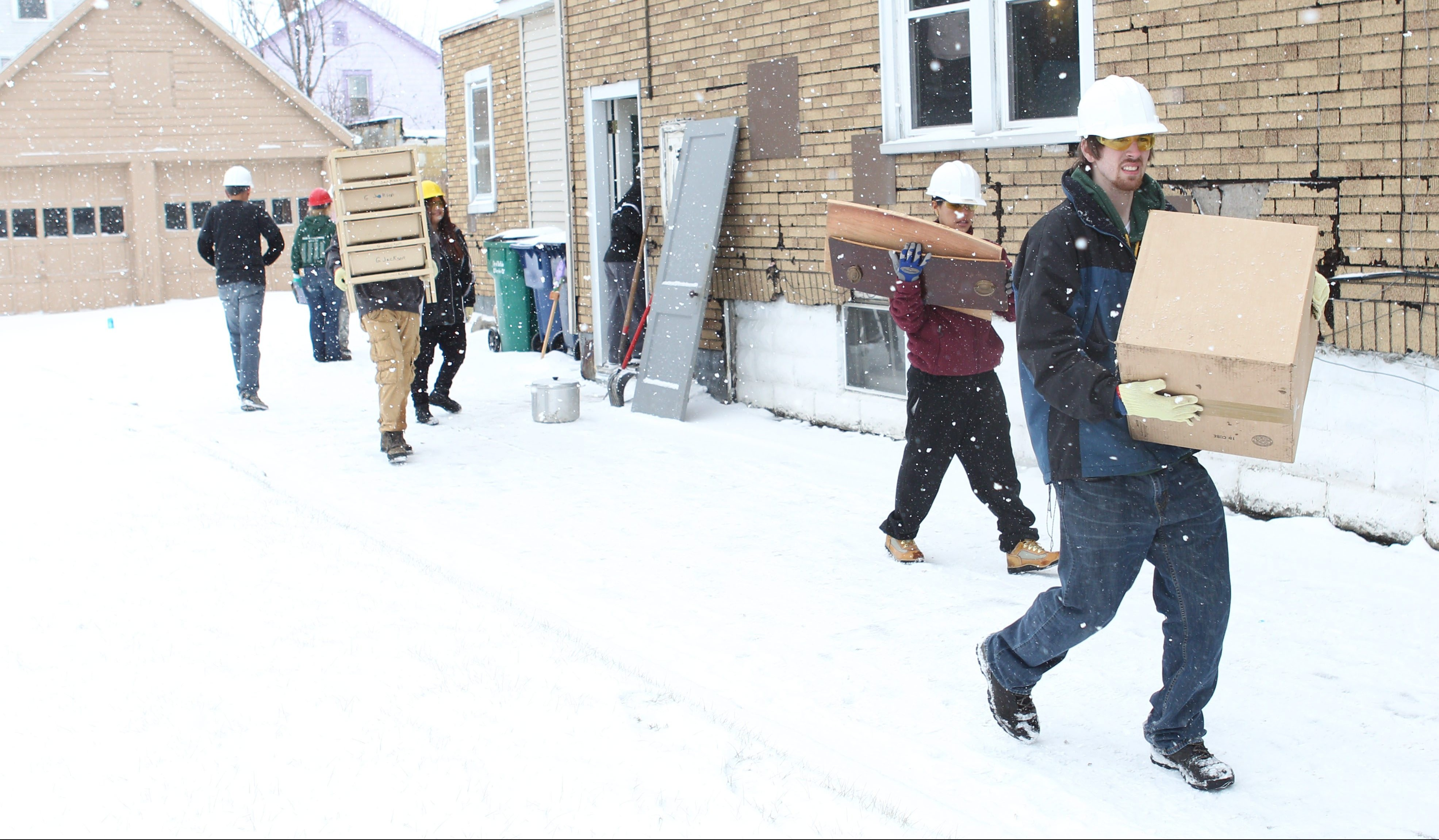 When Habitat for Humanity volunteers clear out homes donated to the charity -- as at this Wilkes Street residence in 2014 -- sometimes they find unusual things tucked in the house's nooks and crannies. (Sharon Cantillon/News file photo)
