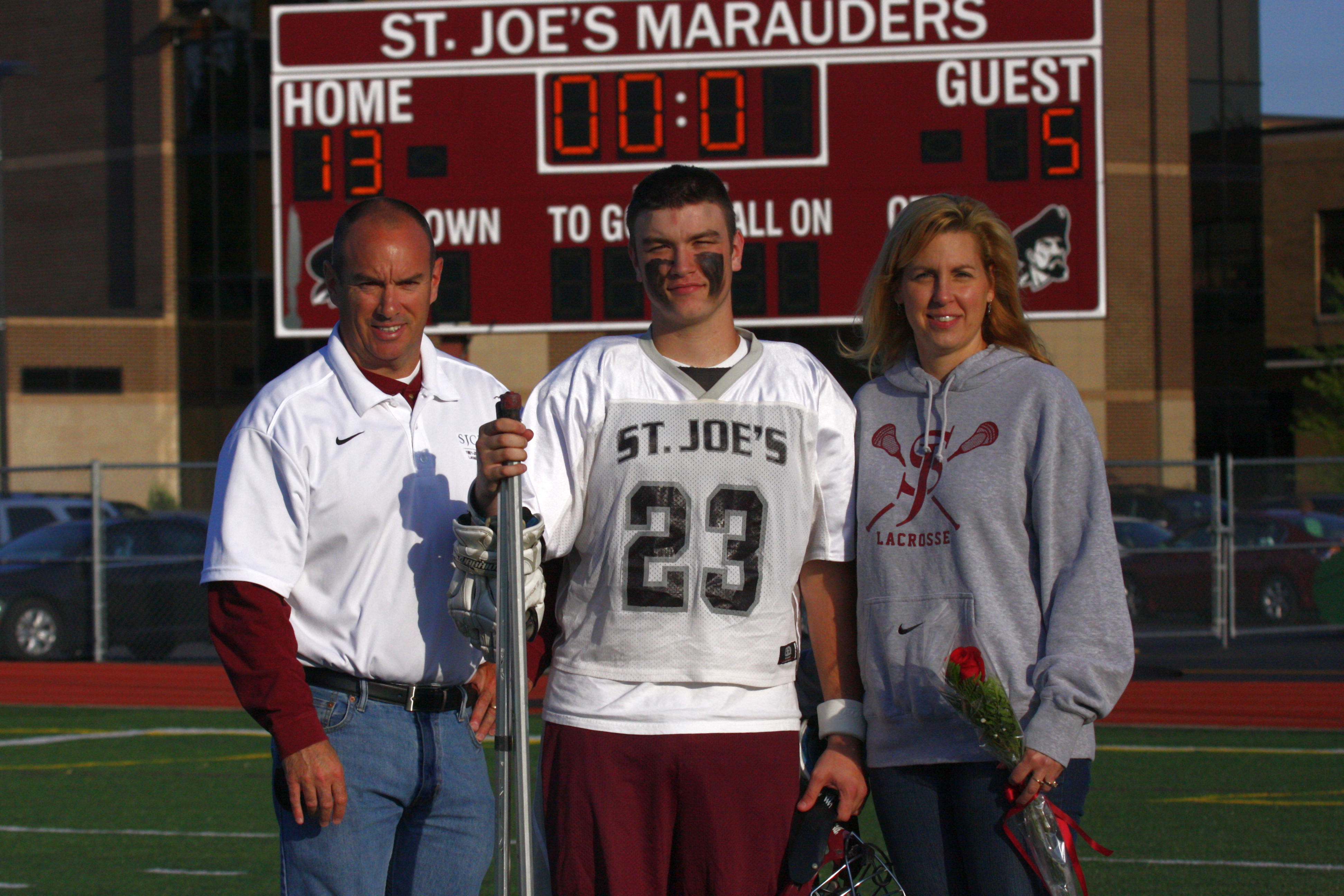 Paul Sr. and Denise Englert flank their son, Paul Jr., who played varsity lacrosse for four years at St. Joseph's Collegiate Institute and died in September 2013 from a pulmonary embolism.