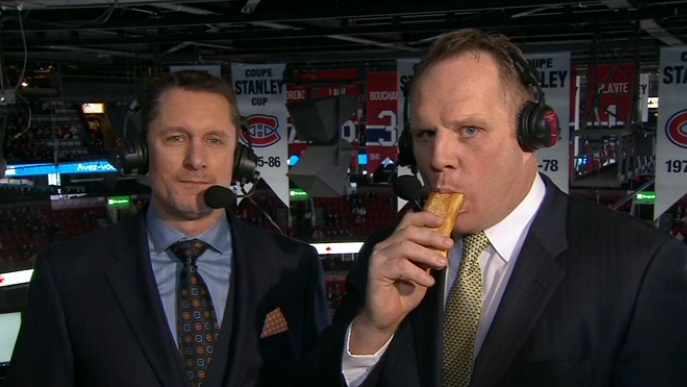 Sabres broadcaster Rob Ray mows down a hot dog on MSG Wednesday night during the telecast of the Sabres-Canadiens game. (Screenshot from ESPN)