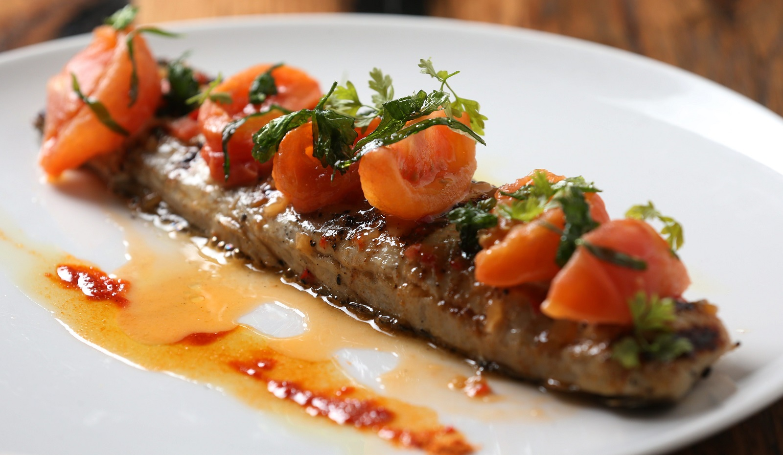 Toutant's wood-grilled red drum fish is among Andrew Galarneau's picks for this outside-the-box fish feature. (Sharon Cantillon/Buffalo News)