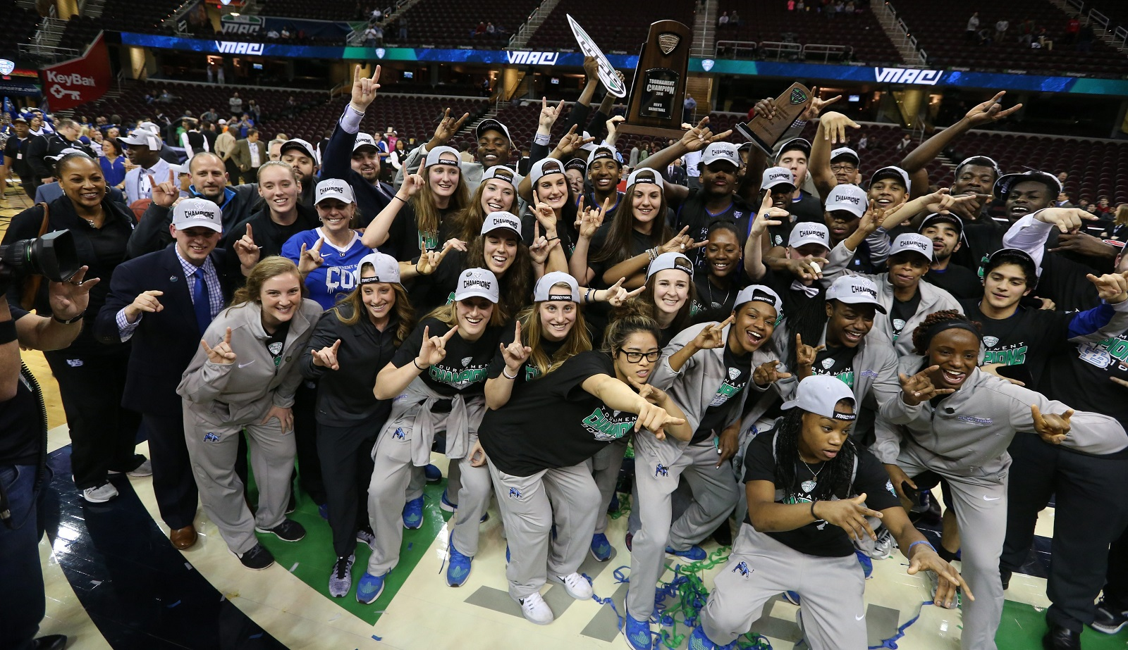 The University at Buffalo men and women's basketball teams pose in the same photo after both won their conference tournaments in Cleveland. (James P. McCoy/ Buffalo News)