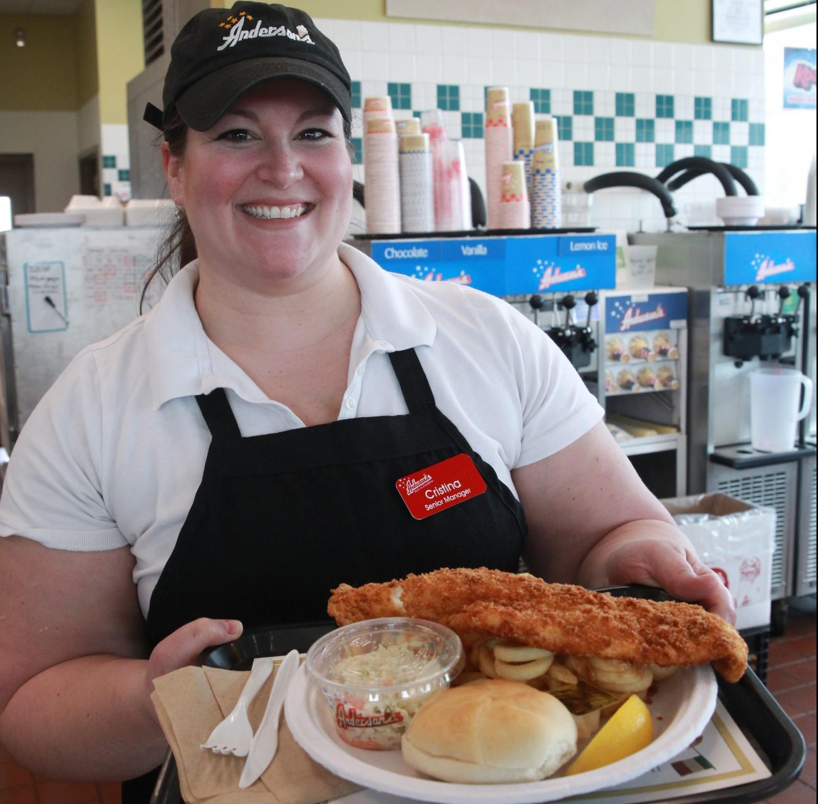 Cristina Anderson serves a fish fry at Anderson's in Cheektowaga. (John Hickey/Buffalo News)
