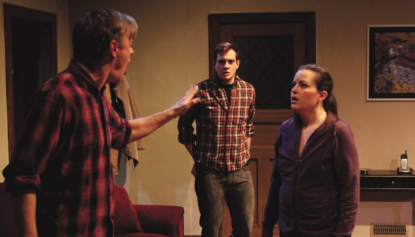 """Christopher Evans, Jesse Tiebor and Michele Marie Benzin star in Road Less Traveled Theater's production of """"Safe."""""""