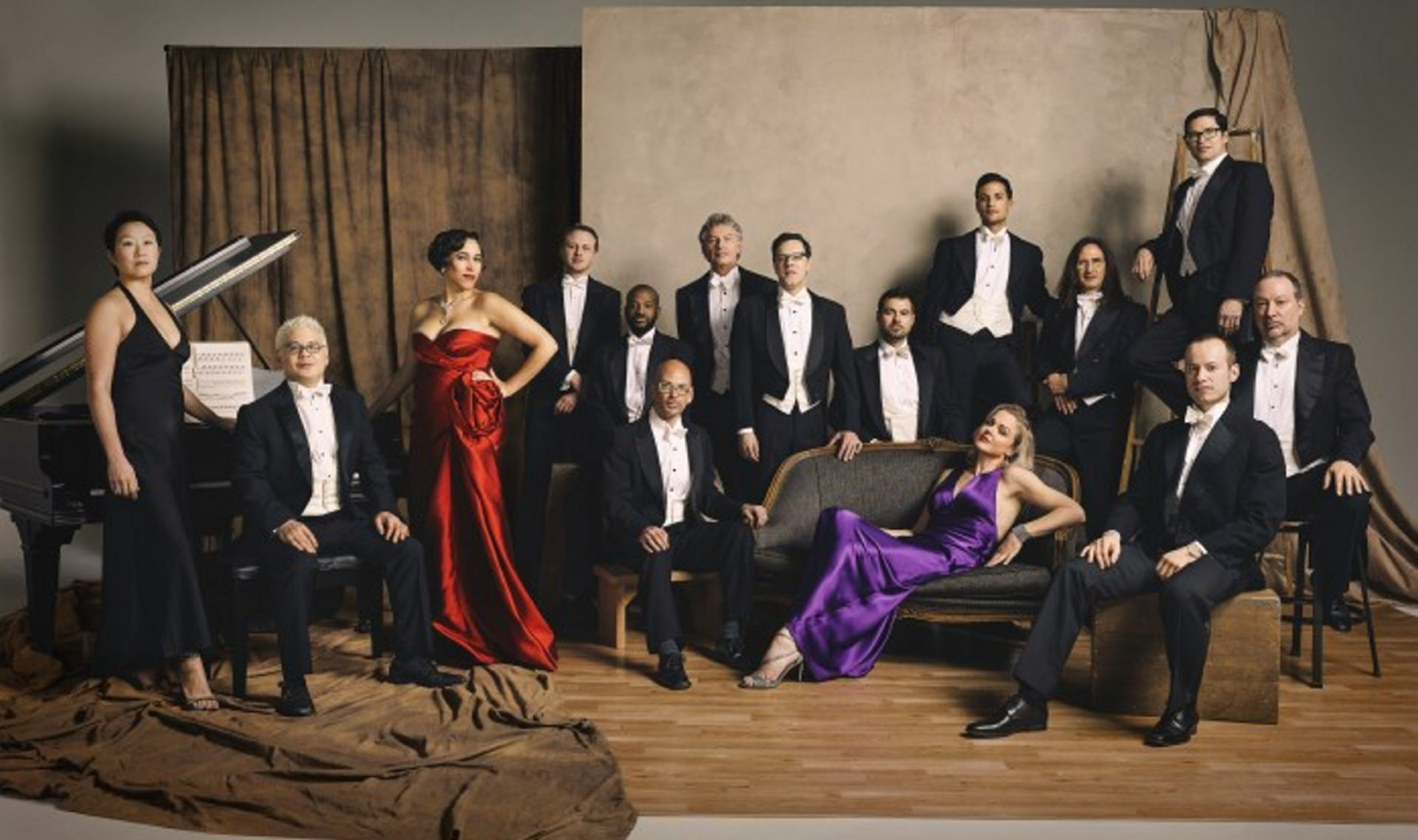 Pink Martini, led by Thomas Lauderdale, seated at piano, joined the Buffalo Philharmonic Orchestra on Saturday.