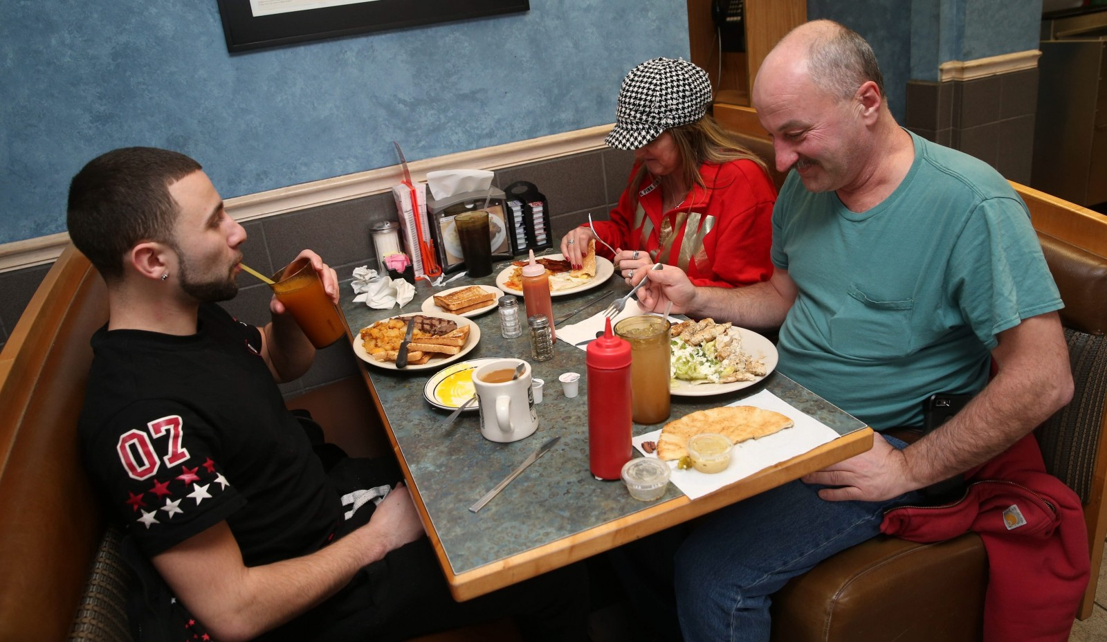 Odyssey Family Restaurant is at 3933 South Park Ave. in Blasdell. Having lunch from left are Dean Bruscia, left, his mother Cheryl Demmerley of Blasdell and Tom Stanley of Orchard Park. See a photo gallery at buffalonews.com.