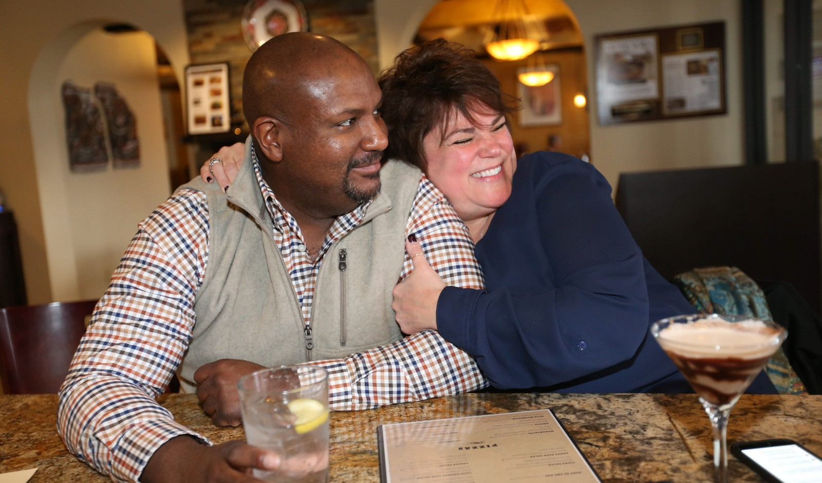 Trevor Holland of Lancaster, Pa., and Pam Hartfield, of Cheektowaga, hang out at Fíero, where one can pretend that Buffalo is a balmy Mediterranean country.