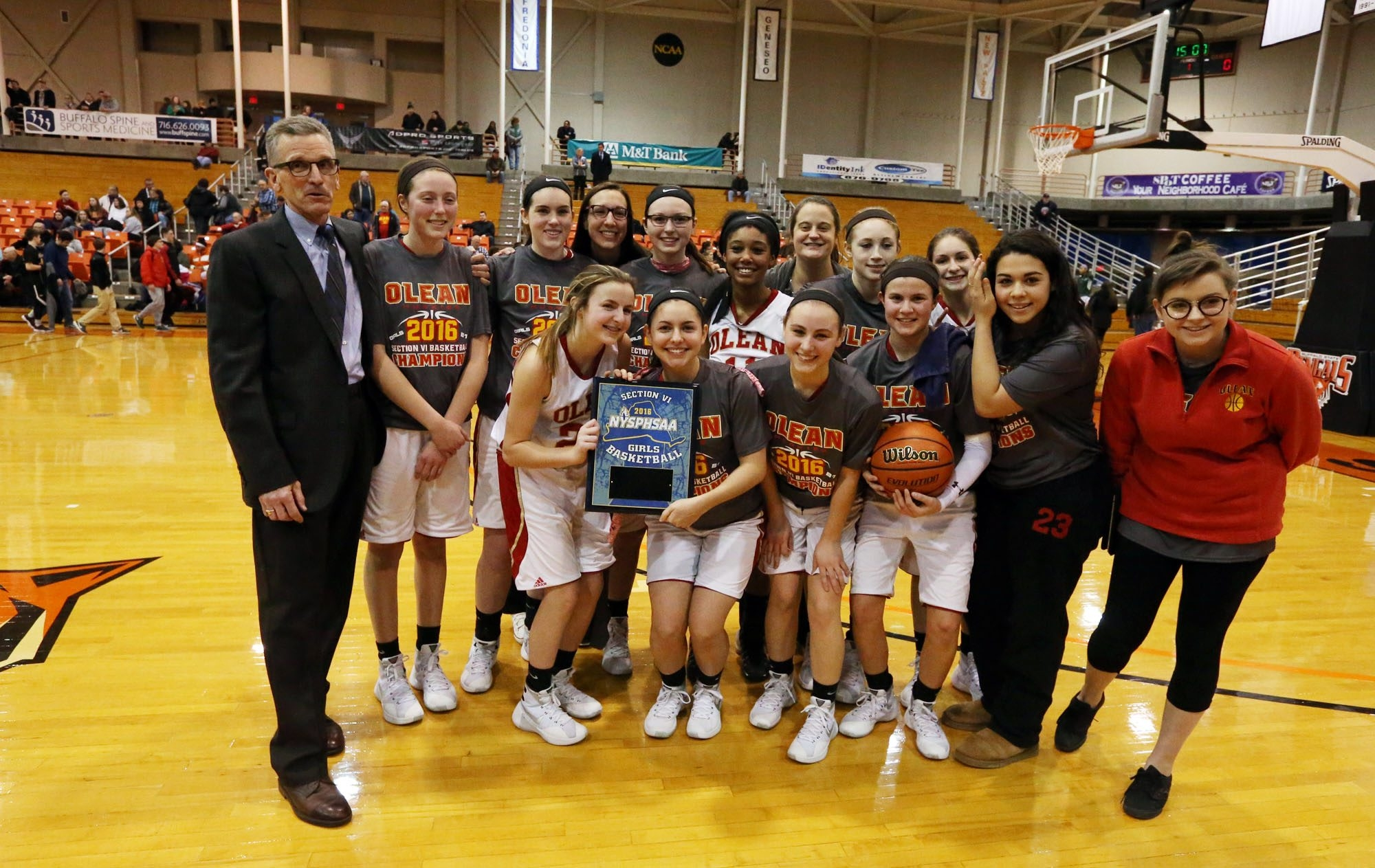 Coach Randy Samuelson and his Olean Huskies celebrate their Section VI Class B championship win at the Buffalo State Sports Arena on Wednesday night.