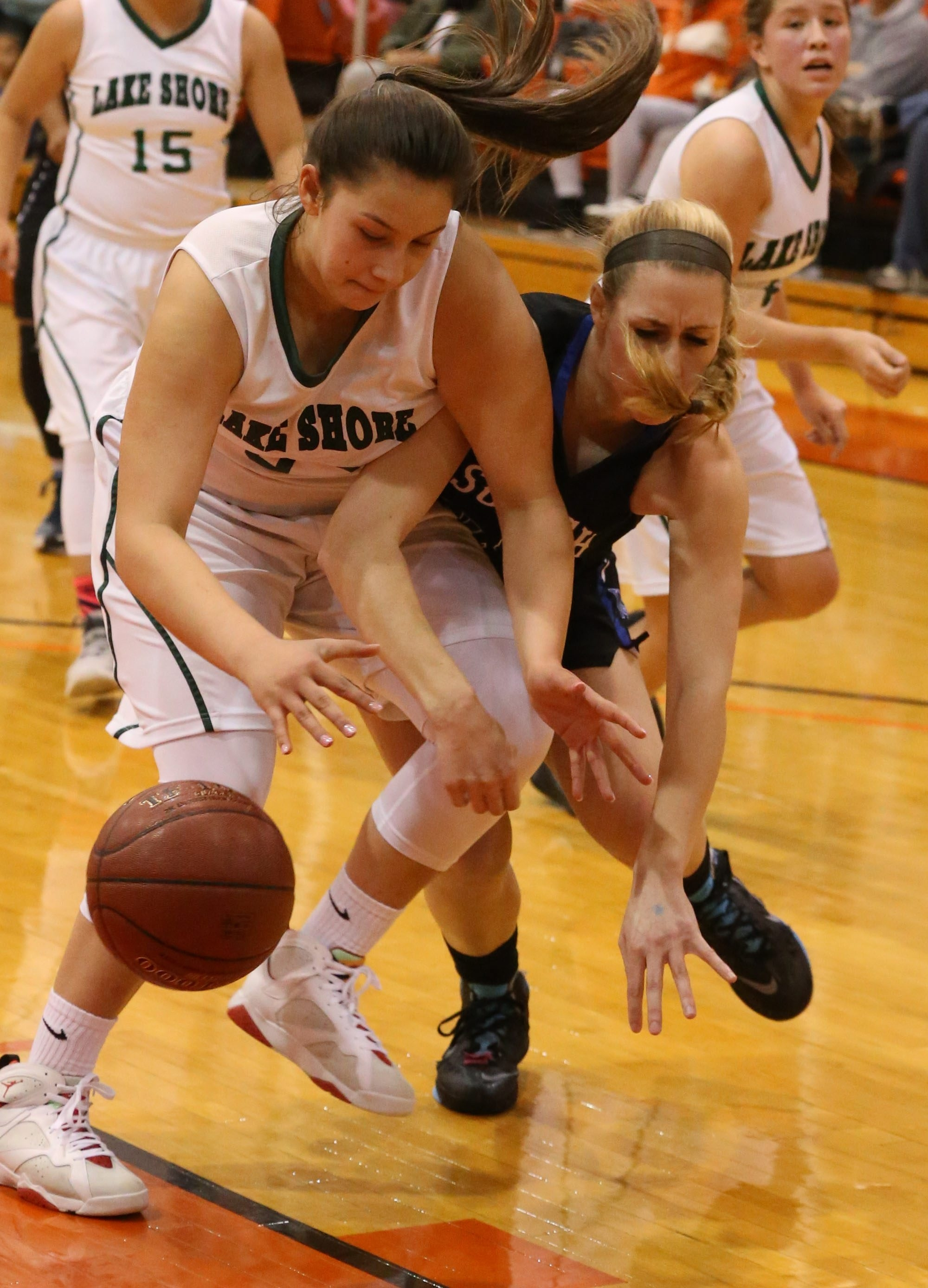 Lake Shore's Shayla Scanlan, left, battles Williamsville South's Brianna Neeley for the ball in the first half.