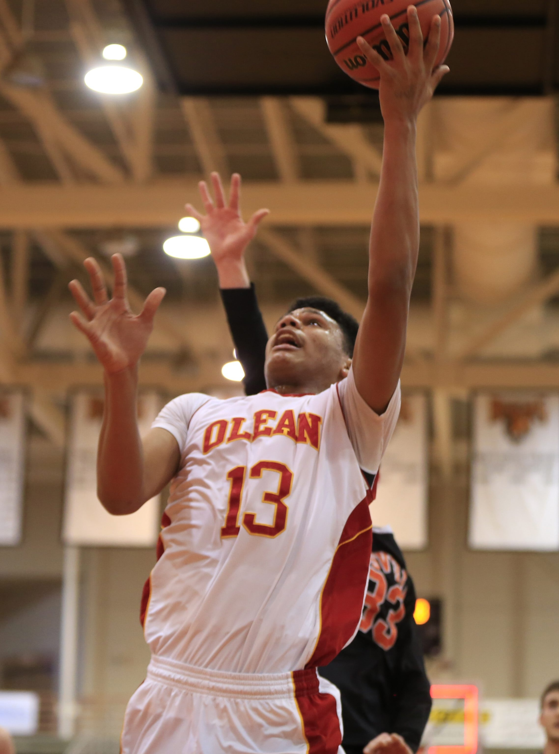 Olean's Elijah Ramadhan works his way inside for two of his 20 points in the Huskies' victory over Wellsville.