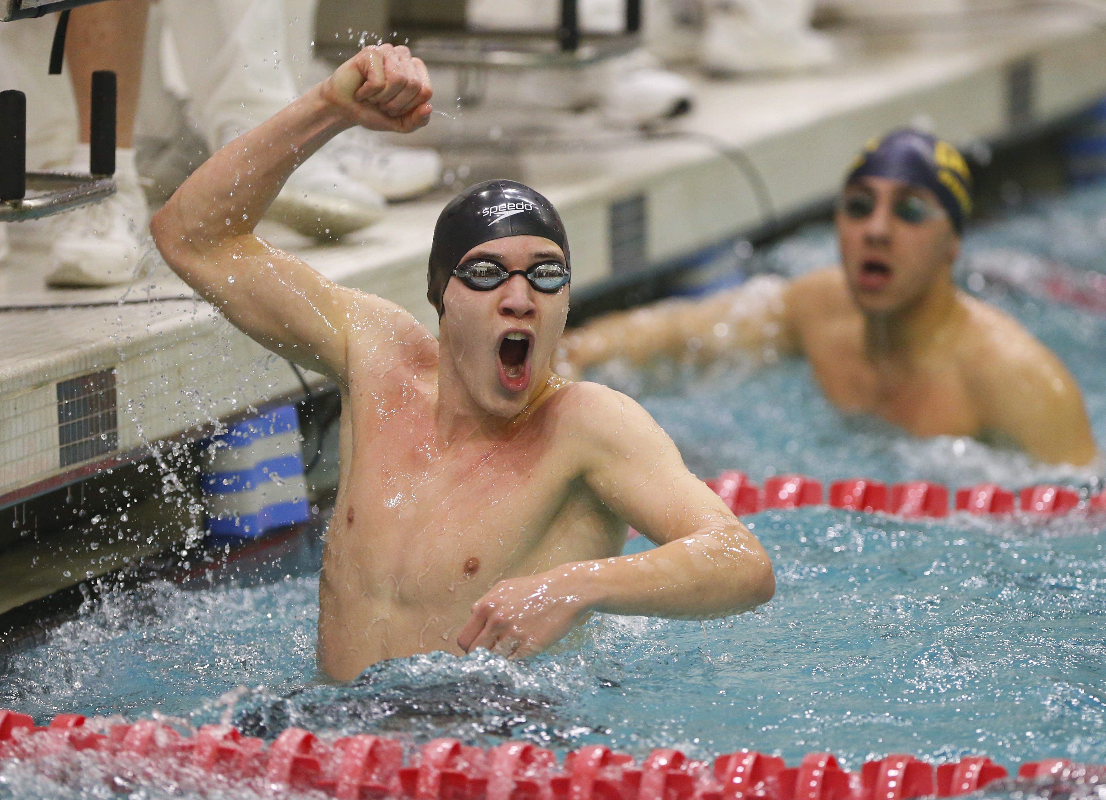 Jamestown's Matthew Marsh celebrates his victory in the 50-yard freestyle at the state championships at Erie Community College on Saturday.