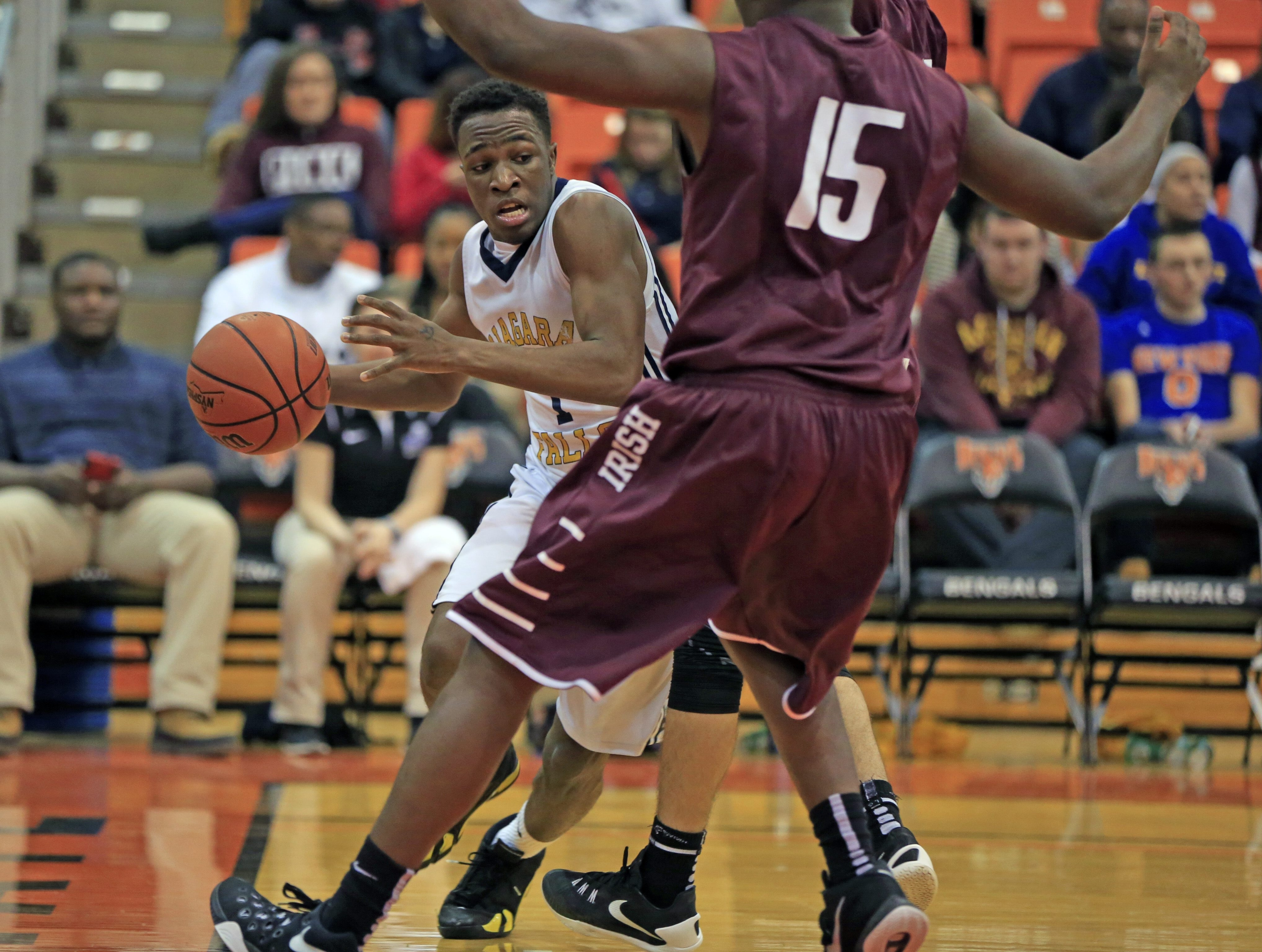 Niagara Falls Breon Harris has nowhere to dribble against Aquinas during the second half of the final game of the day at Buffalo State.