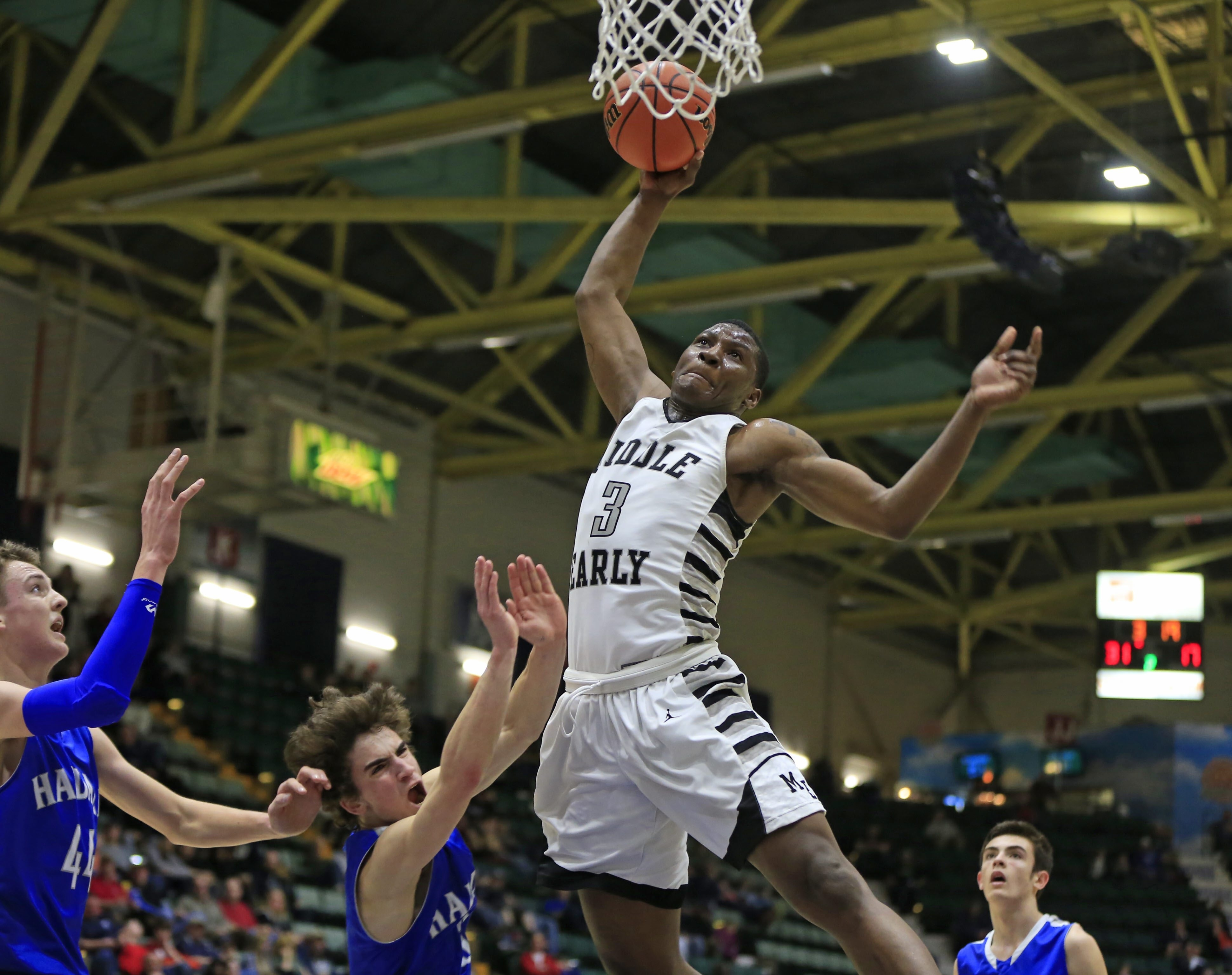Middle Early College's Gary Foster drives to the basket against Haldane in Saturday's New York State Class C Final in Glens Falls.