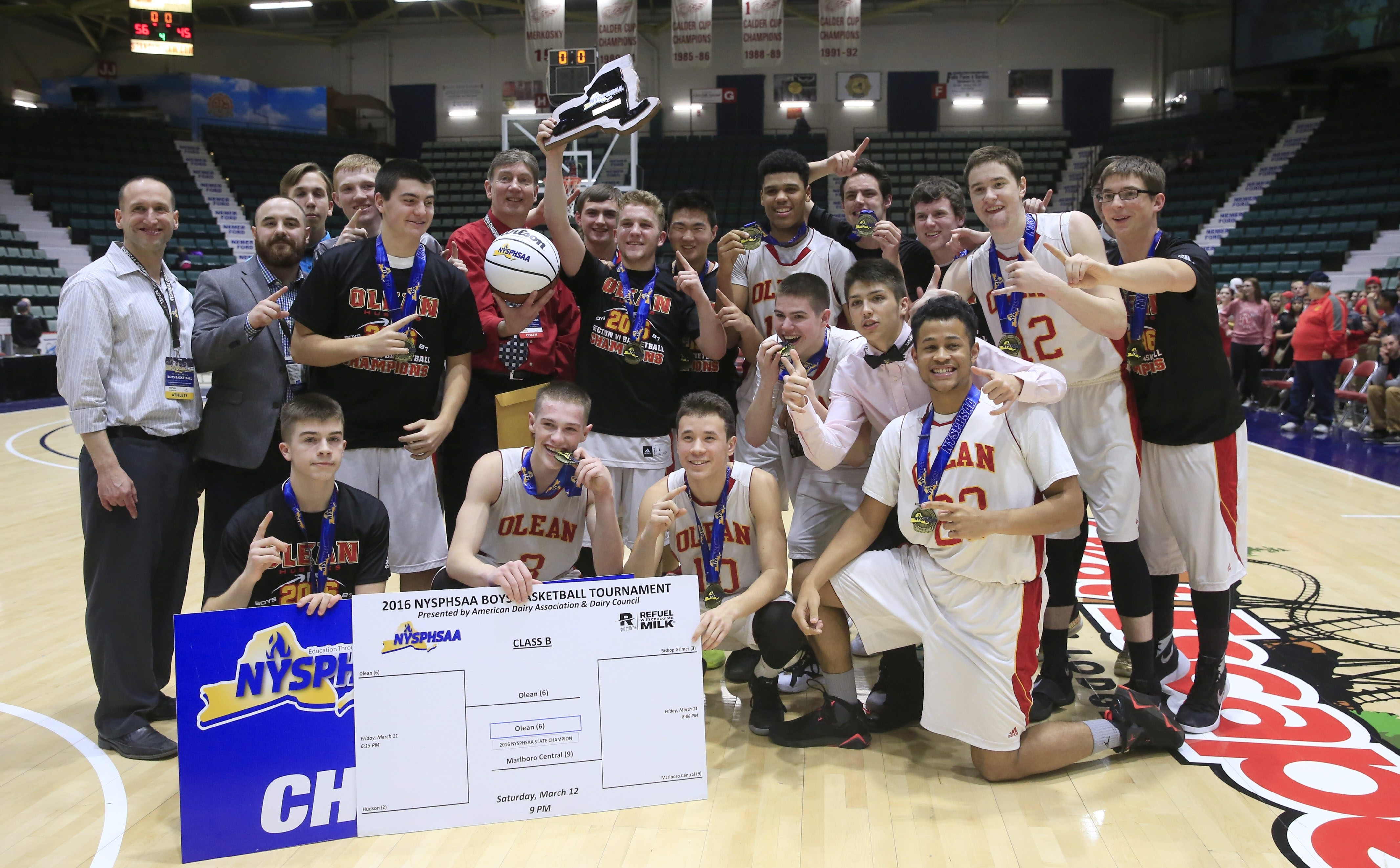 Olean's basketball Huskies show off their rewards for winning the State Public Schools Class B title on Saturday in Glens Falls.