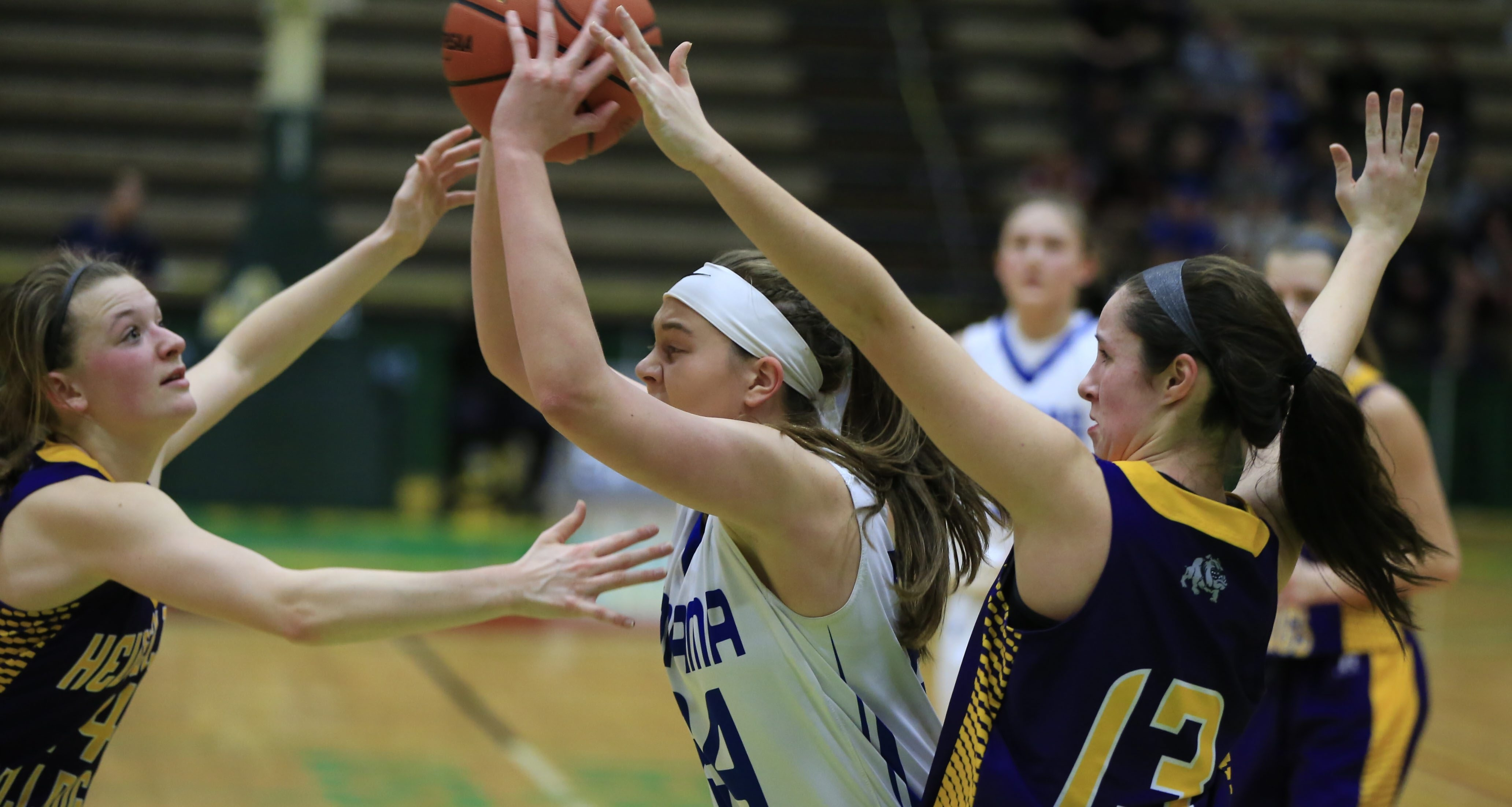 Panama's Nicole Johnson looks to pass against swarming defense by Heuvelton during second-half action of Sunday's Class D final.