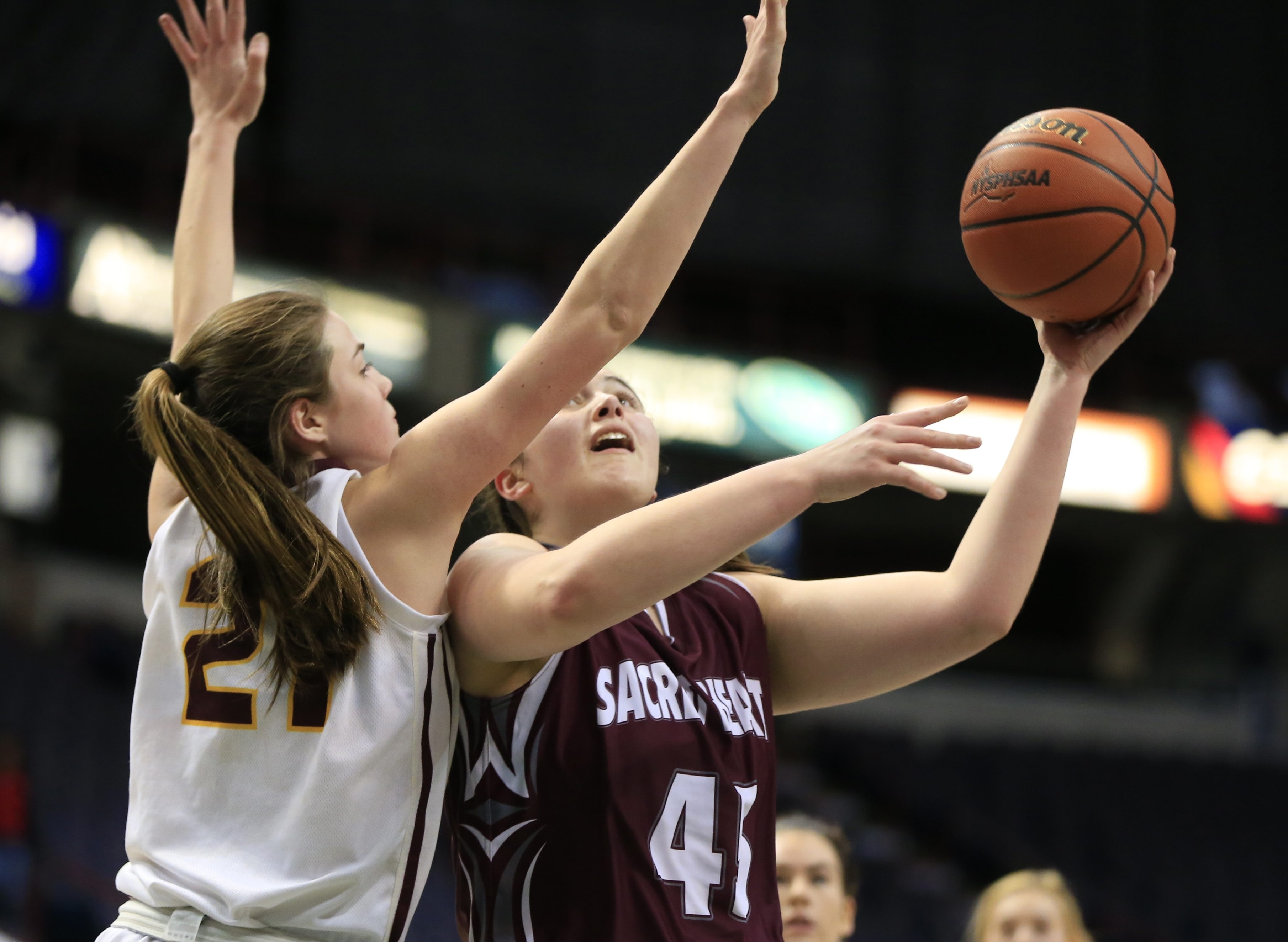 Sacred Heart's Sarah Young shoots over Staten Island Academy's Elizabeth Althoff. Young scored 13 points in her final high school game.