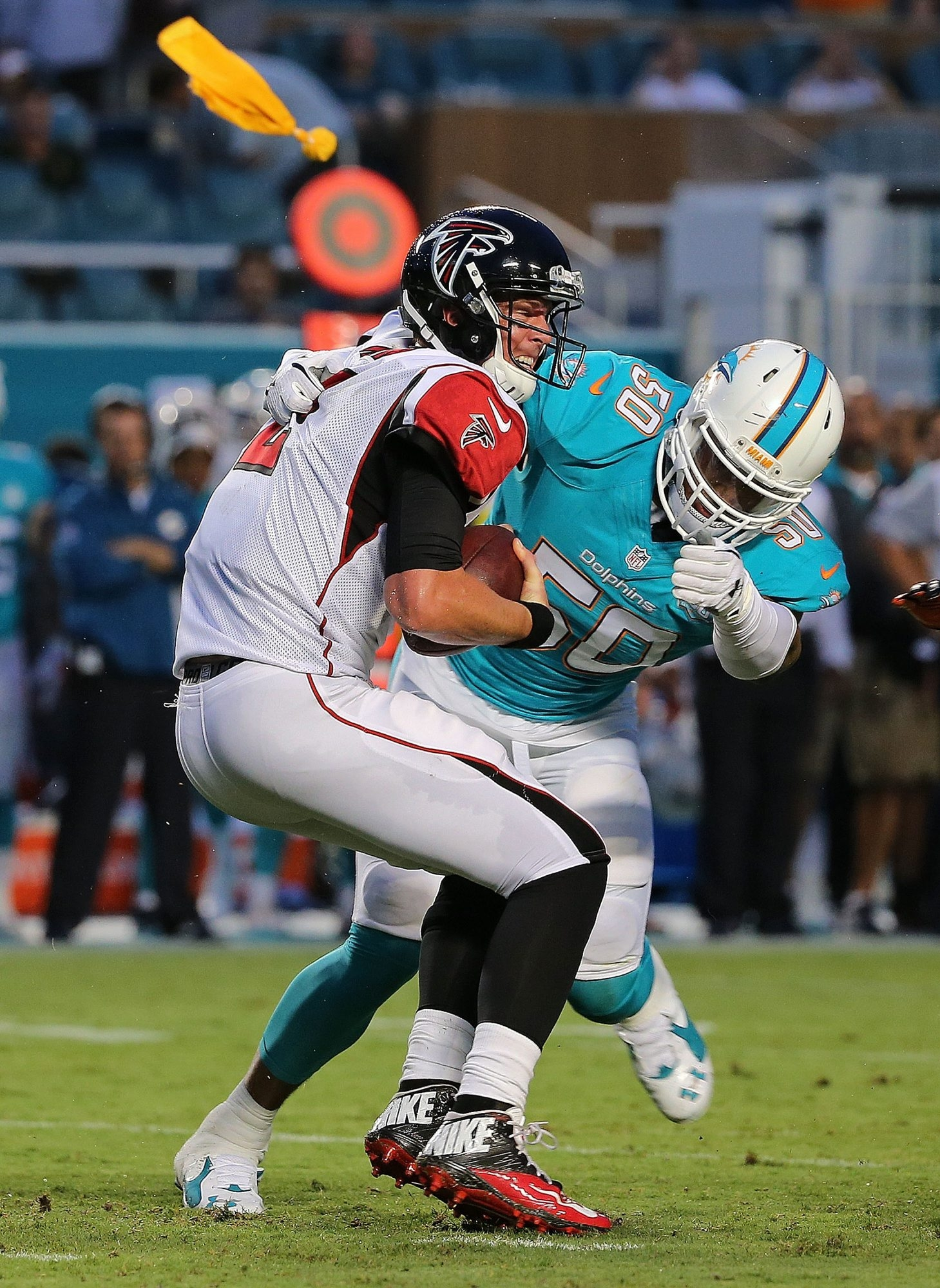 Olivier Vernon (50) of the Miami Dolphins is one of several starting caliber defensive ends available in NFL free agency.