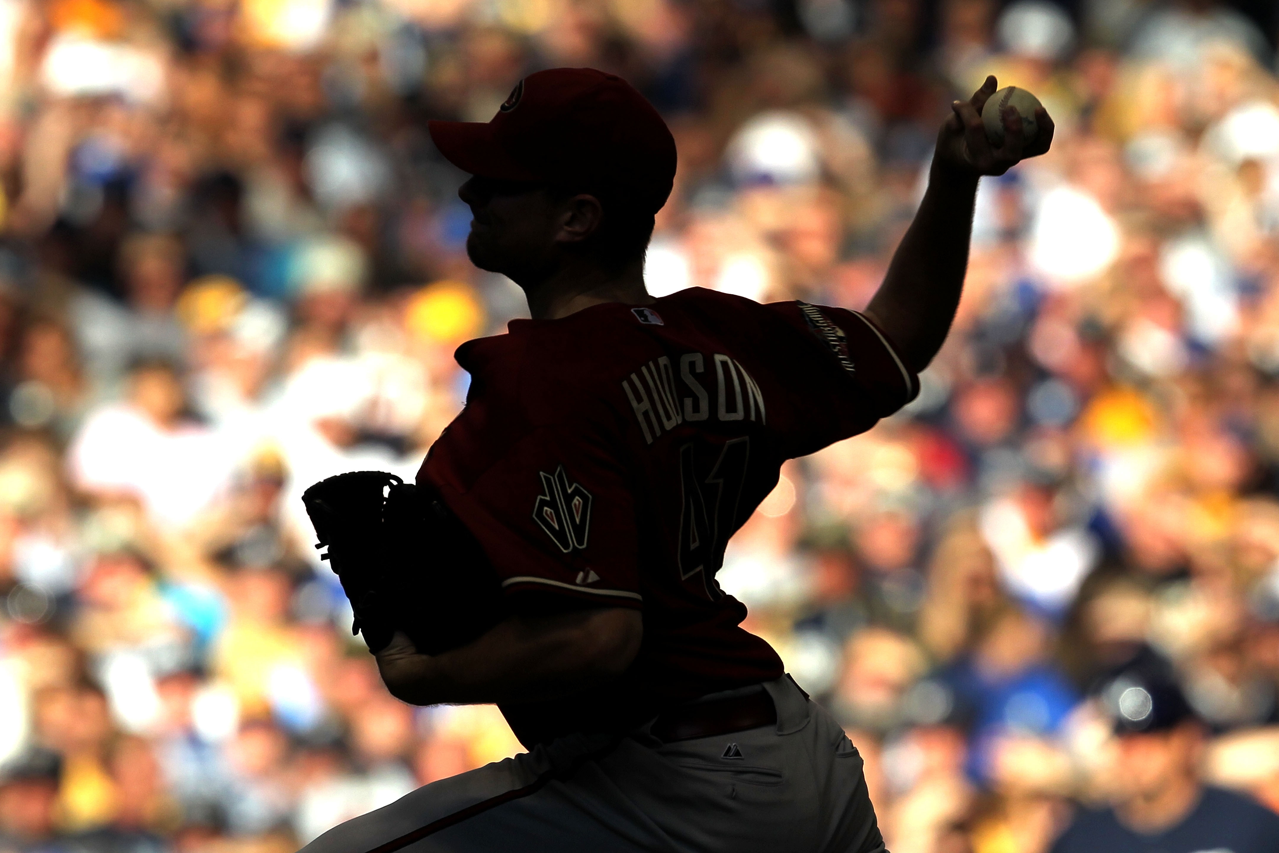 """Daniel Hudson, pitching here in the 2011 NLCS prior to his arm problems, is part of Jeff Passan's book, """"The Arm: Inside the Billion-Dollar Mystery of the Most Valuable Commodity in Sports."""""""