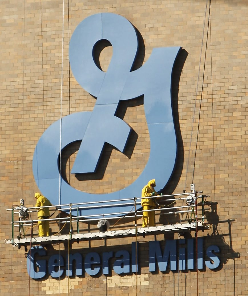 Workers on a lift touch up the logo of the General Mills plant in downtown Buffalo.