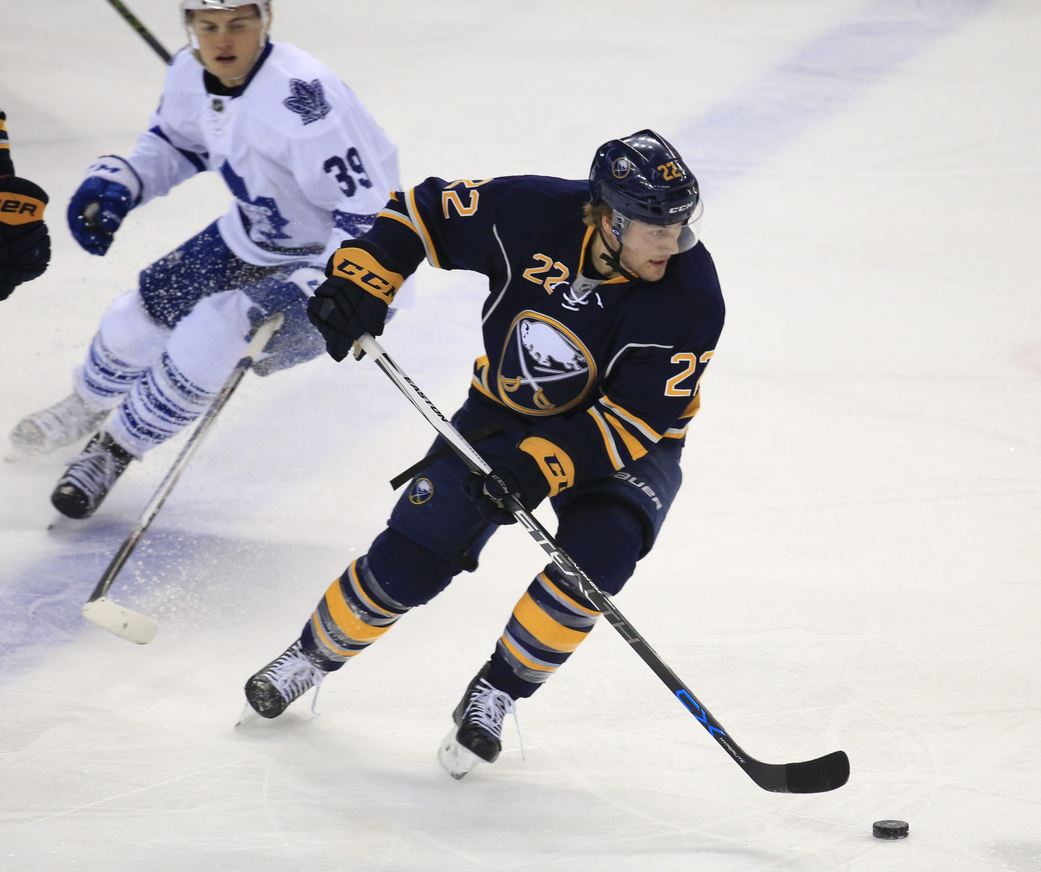 Johan Larsson moves the puck against the Toronto Maple Leafs in the first period Thursday. Larsson scored twice and has seven goals in the last 17 games.