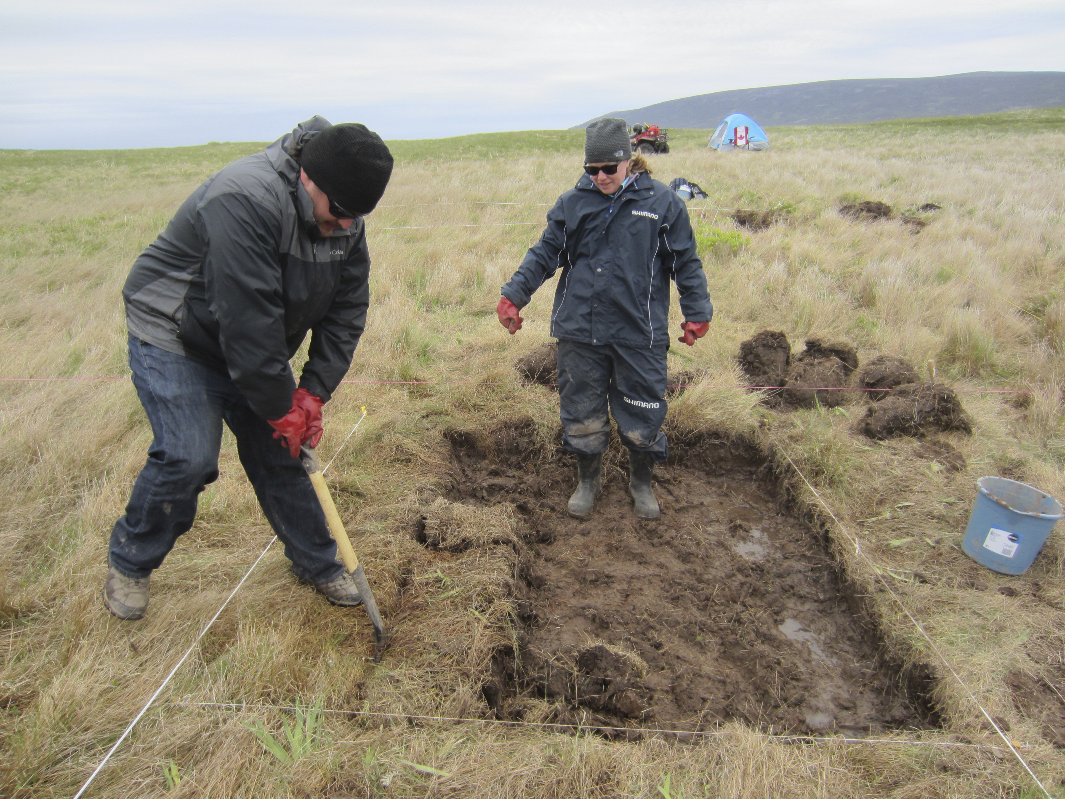 This undated handout photo shows archaeologists Sarah Parcak, right, and Chase Childs looking for a Viking presence in Point Rosie, Newfoundland, Canada. The site may be the second known Viking settlement in North America.