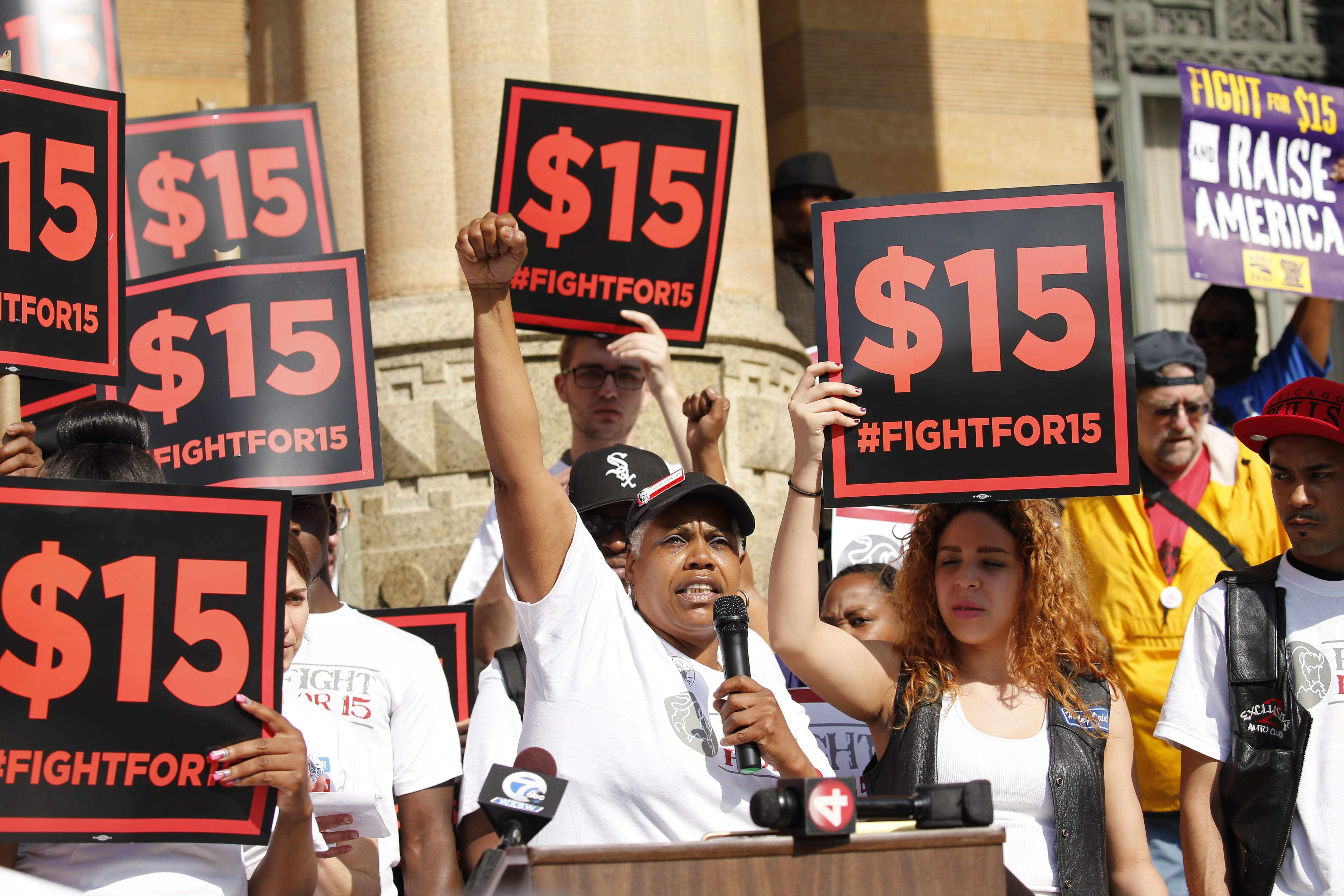 Charmaine Rookard, who works at KFC, speaks during a rally outside Buffalo City Hall to call for a $15/hour minimum wage before a hearing of the governor's wage board last spring.  (Derek Gee/Buffalo News)
