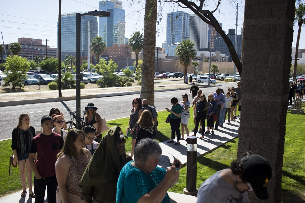 Voters line up outside a Salvation Army community center on primary day in downtown Phoenix last week. Many had to wait hours to cast their vote in Arizona.