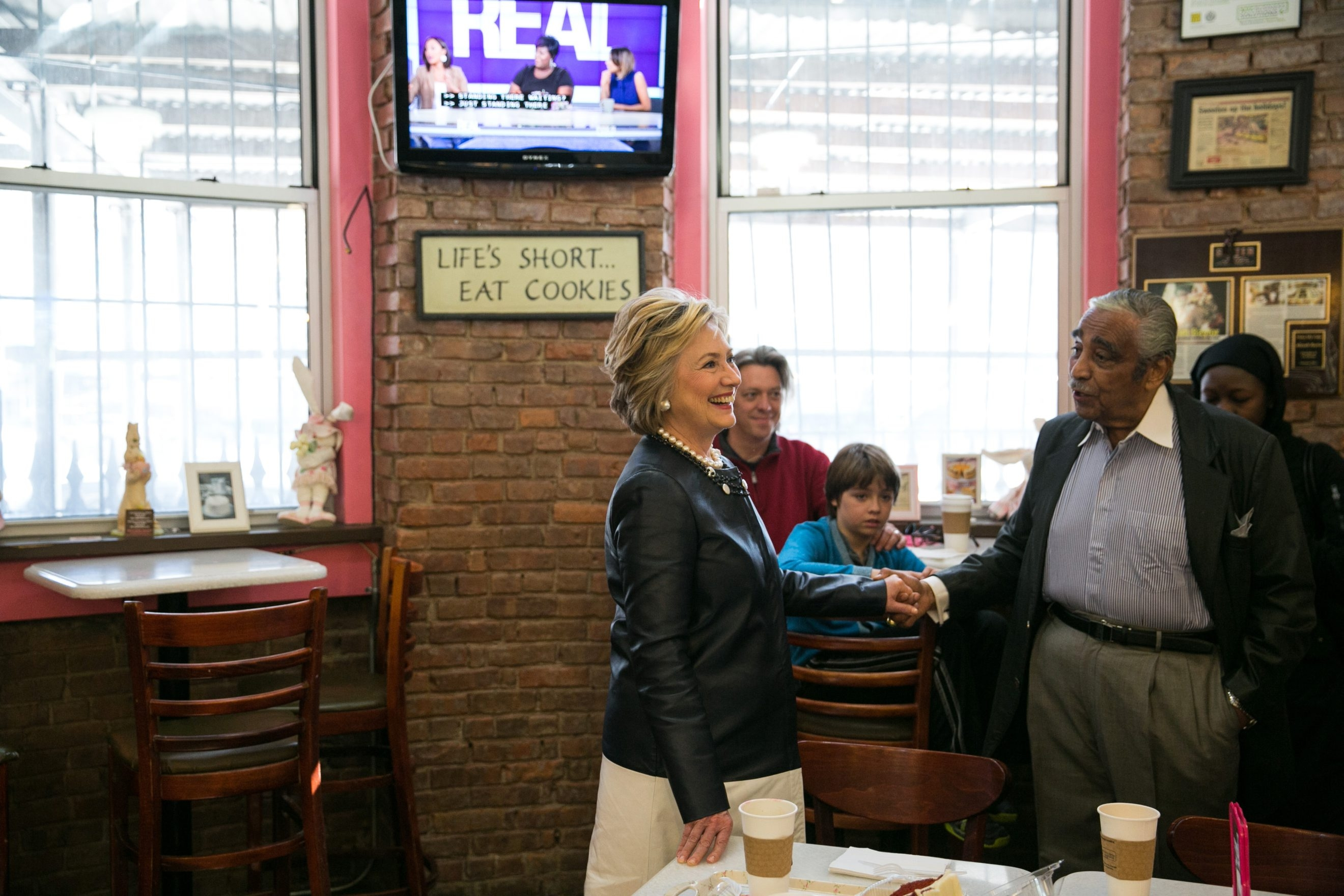 Presidential hopeful Hillary Clinton greets Rep. Charles Rangel, D-N.Y., while campaigning at Make My Cake bakery in Harlem.