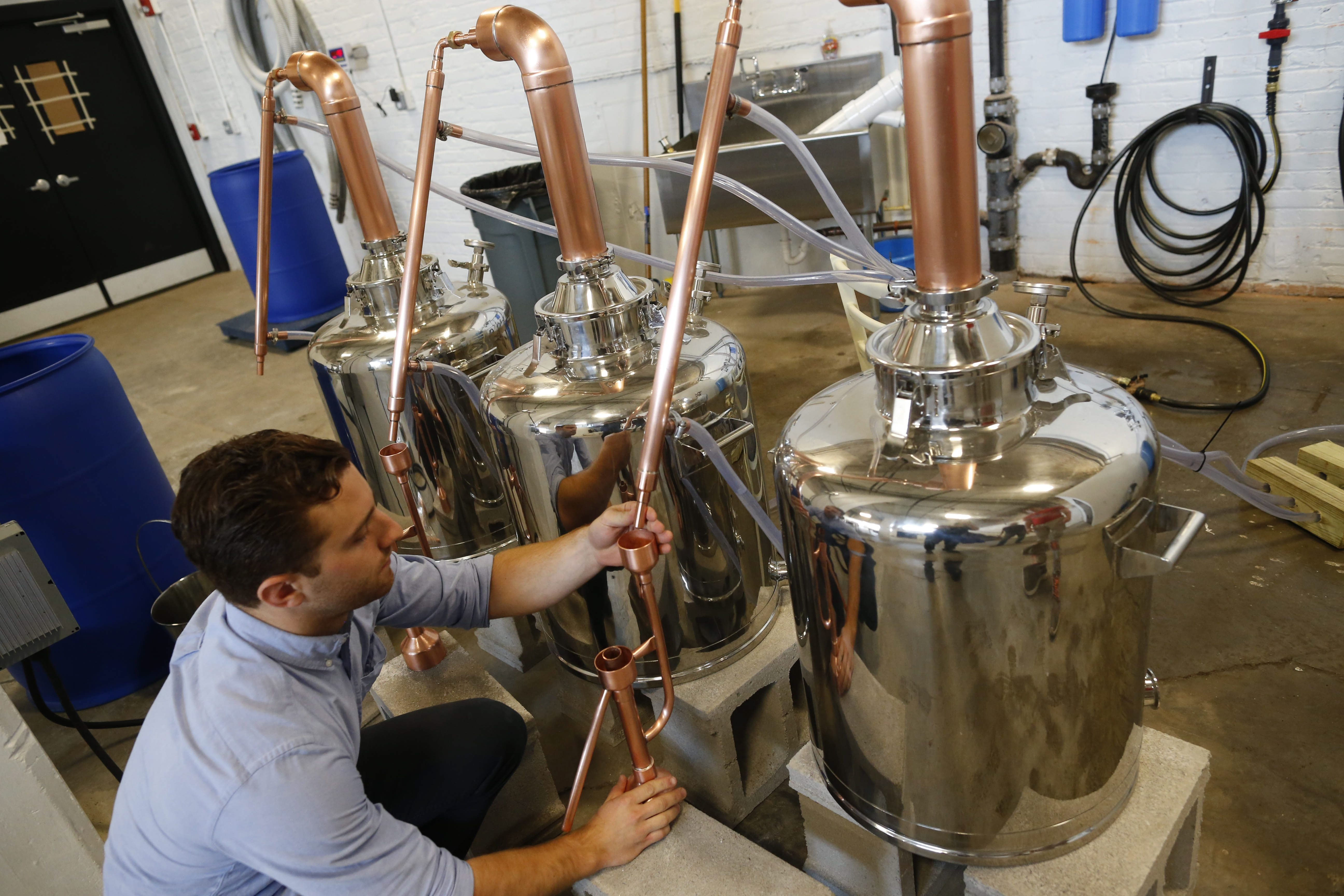 Robert Finan sets up some of the stills to make custom batches of gin, vodka and other spirits using all New York State ingredients at Tommyrotter.